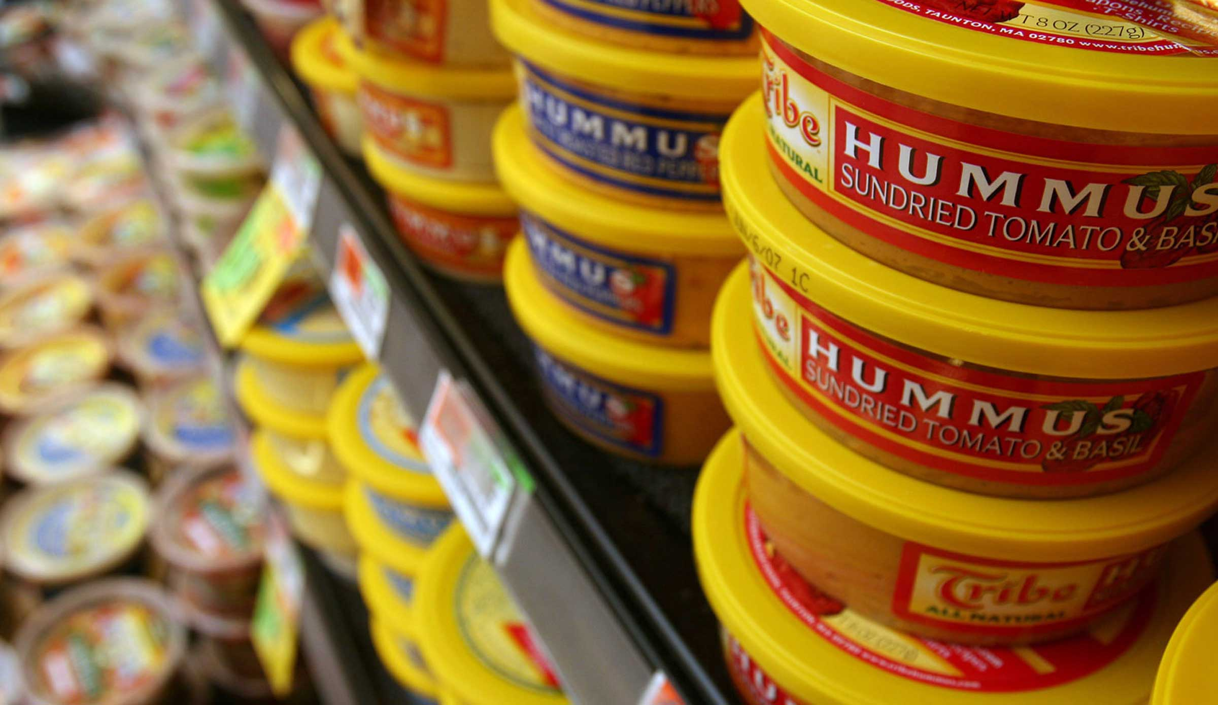 Hummus, once sparse or even non-existent at the local grocer, now often fills an entire refrigerator case like this one at Shaw's supermarket in Concord, N.H. on Tuesday, February 20, 2007