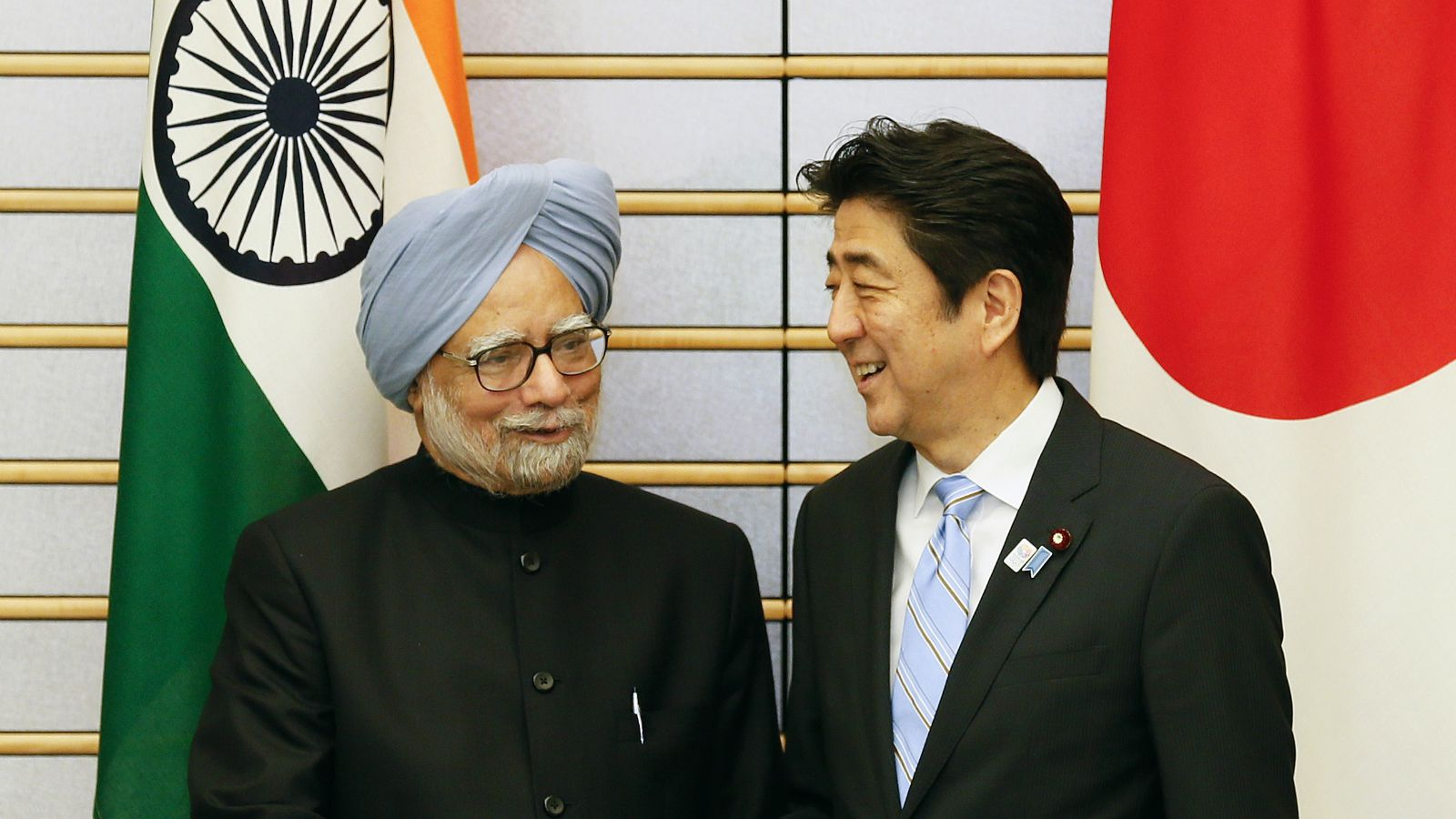 Indian Prime Minister Manmohan Singh, left, shakes hands with his Japanese counterpart Shinzo Abe at the start of talks at the latter's official residence in Tokyo, Wednesday, May 29, 2013.