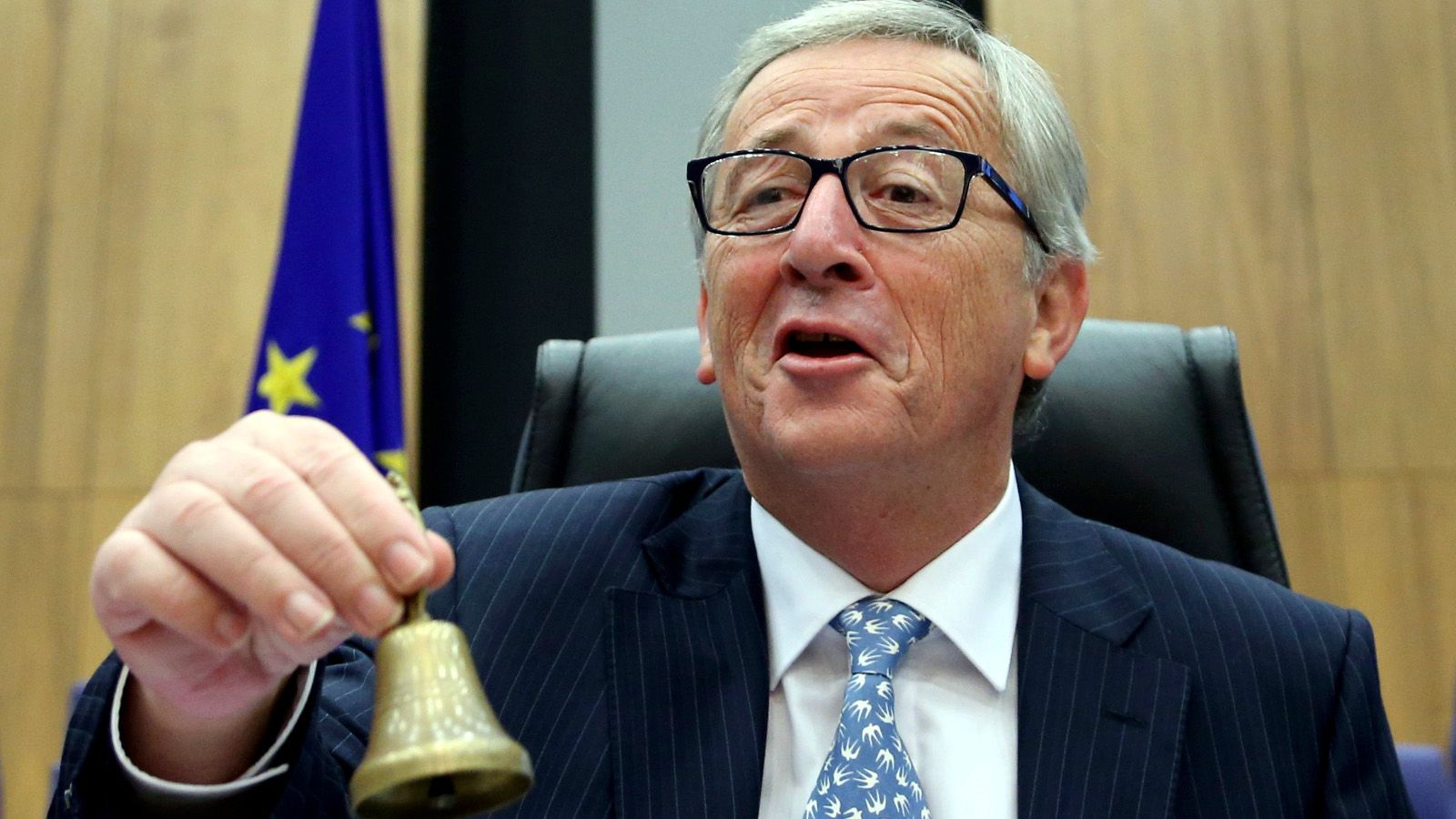The European Commission's new President Jean-Claude Juncker rings the bell as he chairs the first official meeting of the EU's executive body at the EU Commission headquarters in Brussels November 5, 2014.