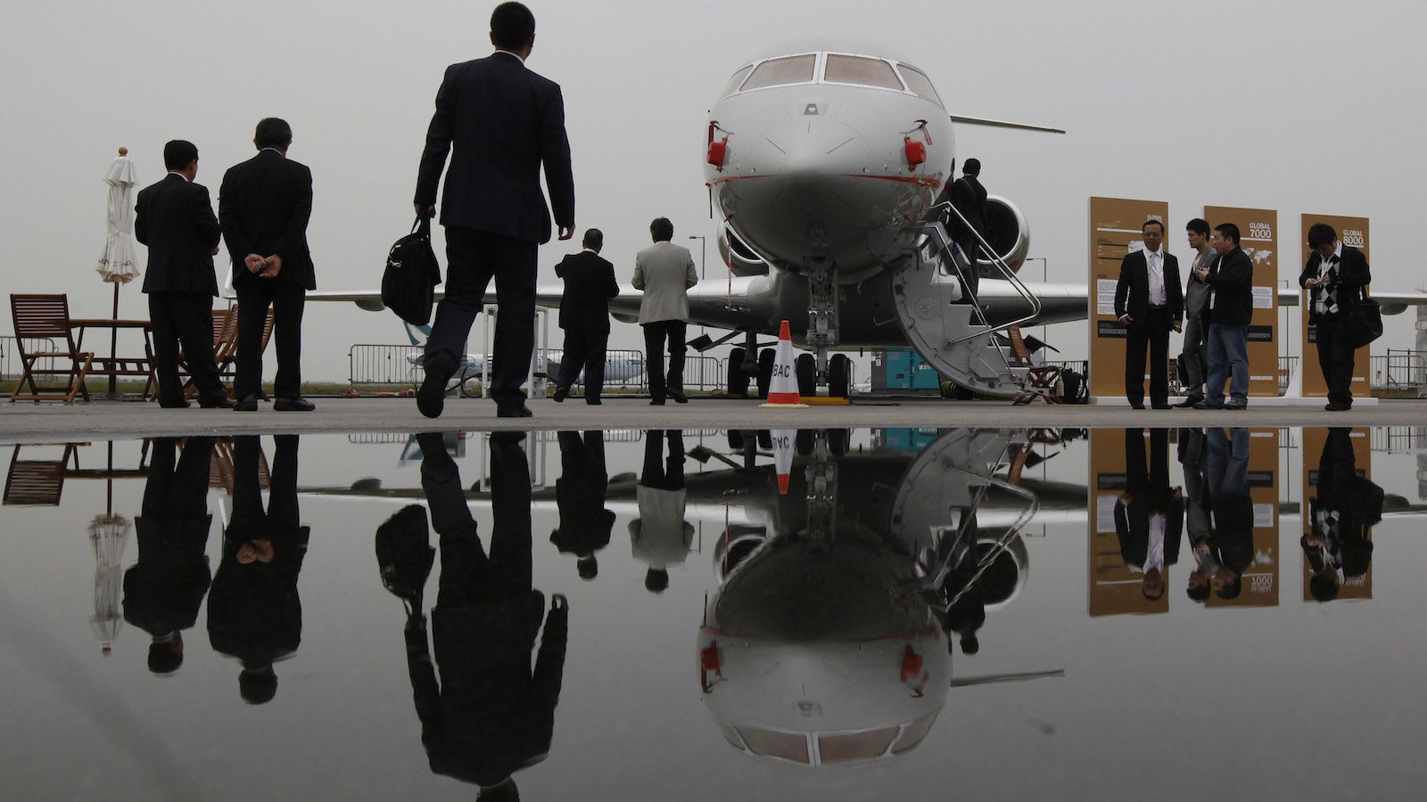 Visitors tour the Bombardier Global Express XRS corporate jet during the Asian Aerospace Show in Hong Kong Tuesday, March 8, 2011. Canada's Bombardier, Brazil's Embraer, and other makers of smaller jets will also be on hand, underscoring their desire to cash in on opportunities for sales of corporate and private jets. (AP Photo/Kin Cheung)