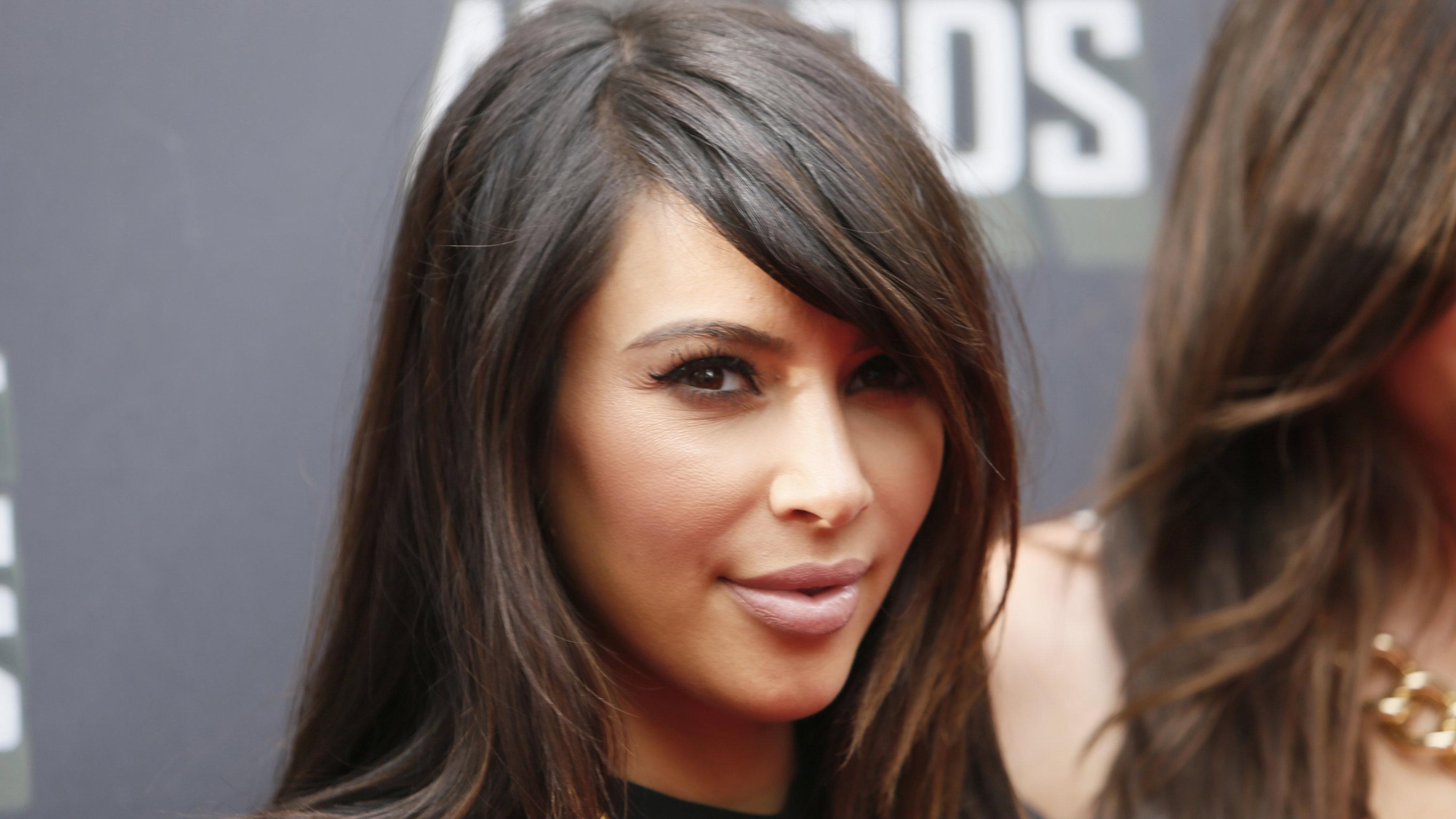 Kim Kardashian arrives at the Teen Choice Awards 2014 in Los Angeles, California August 10, 2014.