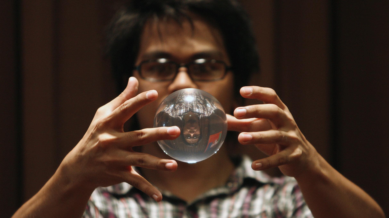 Magician levitating an orb
