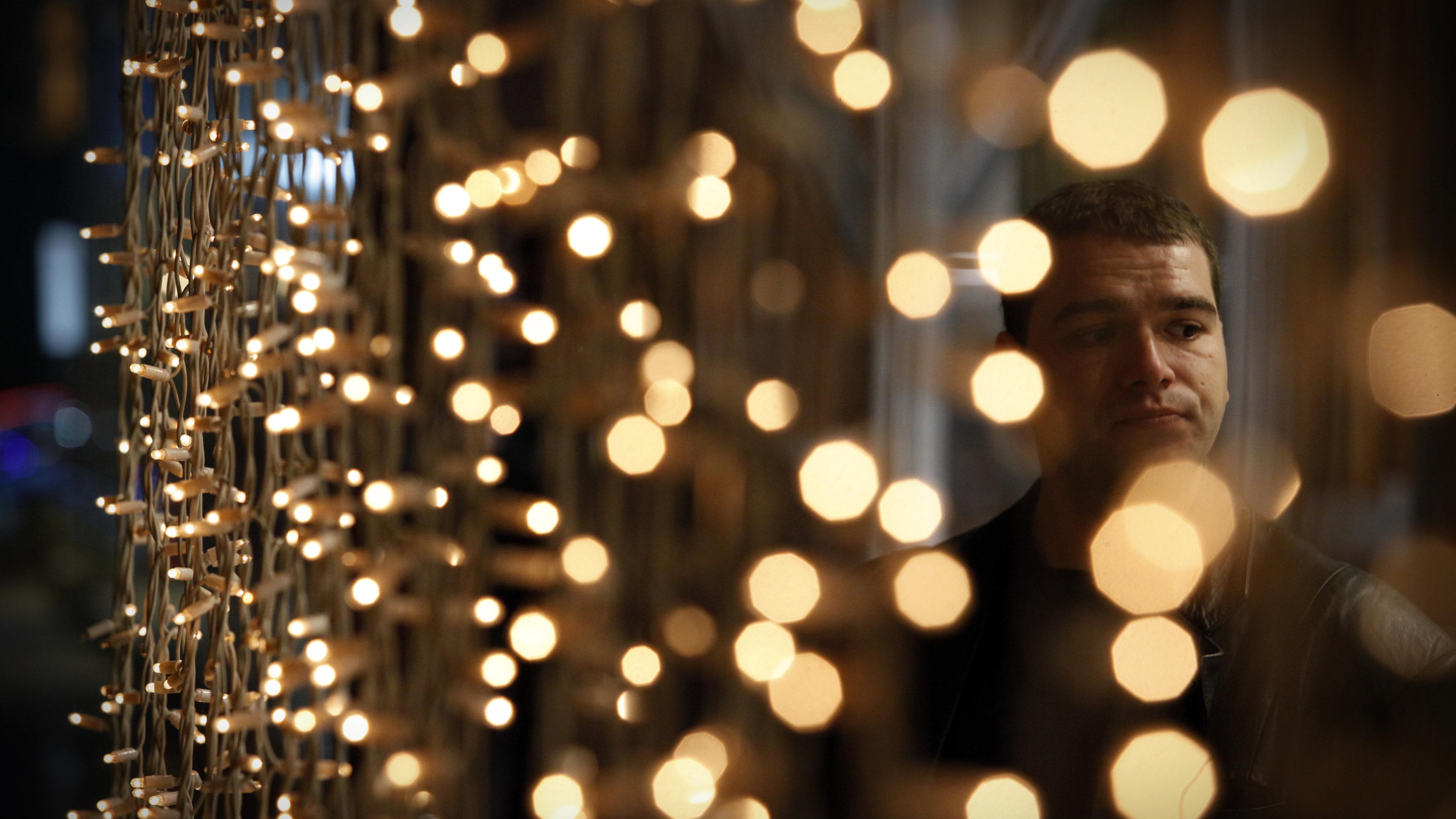 Man and christmas lights shopping