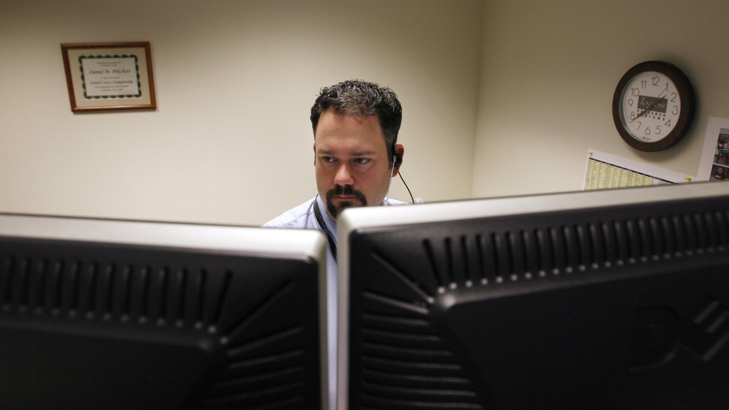 man behind monitors