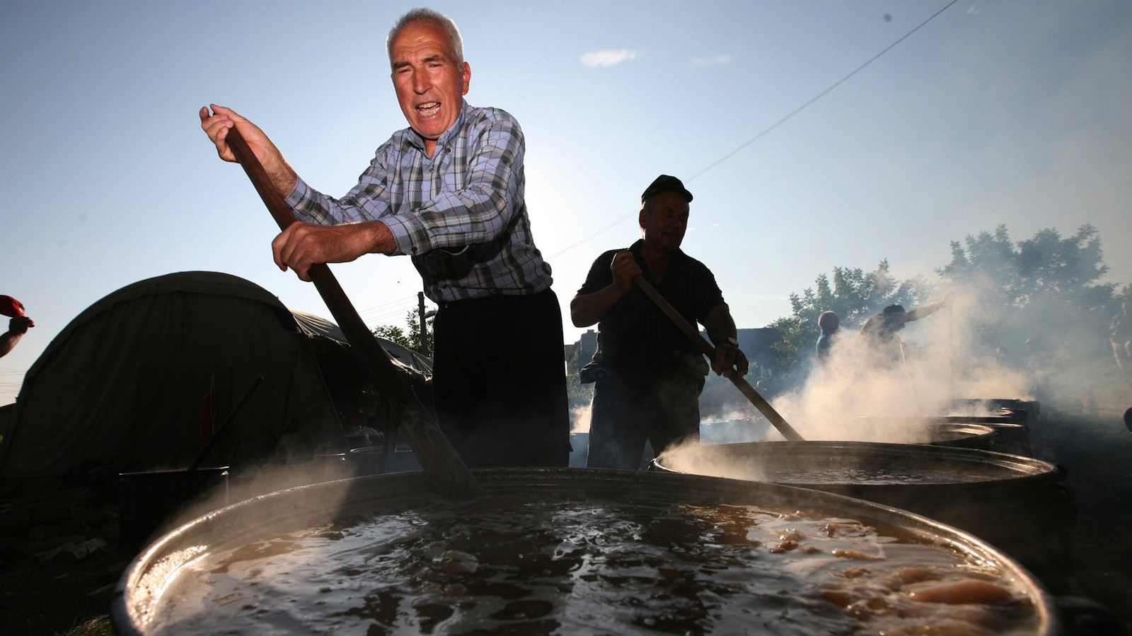 """Bulgarian Muslims cook as they stir """"kurban"""" or boiled mutton, in pots during the traditional prayer festival for a rich harvest, in the village of Dolni Voden, some 160 kms. (100 miles) east of the Bulgarian capital Sofia, Sunday, June 17, 2007."""
