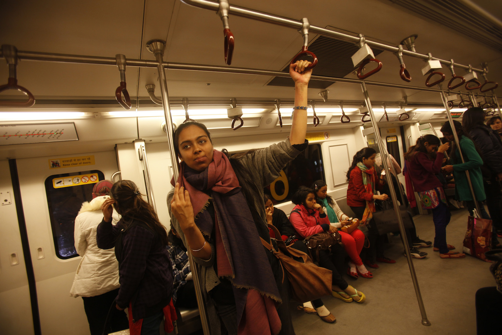 """Simrat, 24, who works for a non-profit arts organisation, travels in the women's compartment of a metro in New Delhi January 12, 2013. """"I made the decision to use public transport as my primary way of moving through the city because I really believe that it is my right to be able to use public space, just as much as it is of any man's"""", Simrat said. """"Not using the metro or an auto or a bus or a cycle rickshaw (because it might not be a safe thing to do) is not an option in my mind because if I stop myself from living my life in ways that are most convenient to me, I'm giving into fear and ceding my independence. I use the metro because it's the most convenient travel option for me and I will continue to do so"""". Since a medical student died after being gang raped on a bus in New Delhi, the issue of women's security in India has been under the spotlight.  Picture taken January 12, 2013.  REUTERS/Mansi Thapliyal (INDIA - Tags: CRIME LAW SOCIETY)  ATTENTION EDITORS: PICTURE 17 OF 20 FOR PACKAGE 'VOICES OF INDIAN WOMEN' SEARCH 'MANSI WOMEN' FOR ALL IMAGES - RTR3CS8O"""