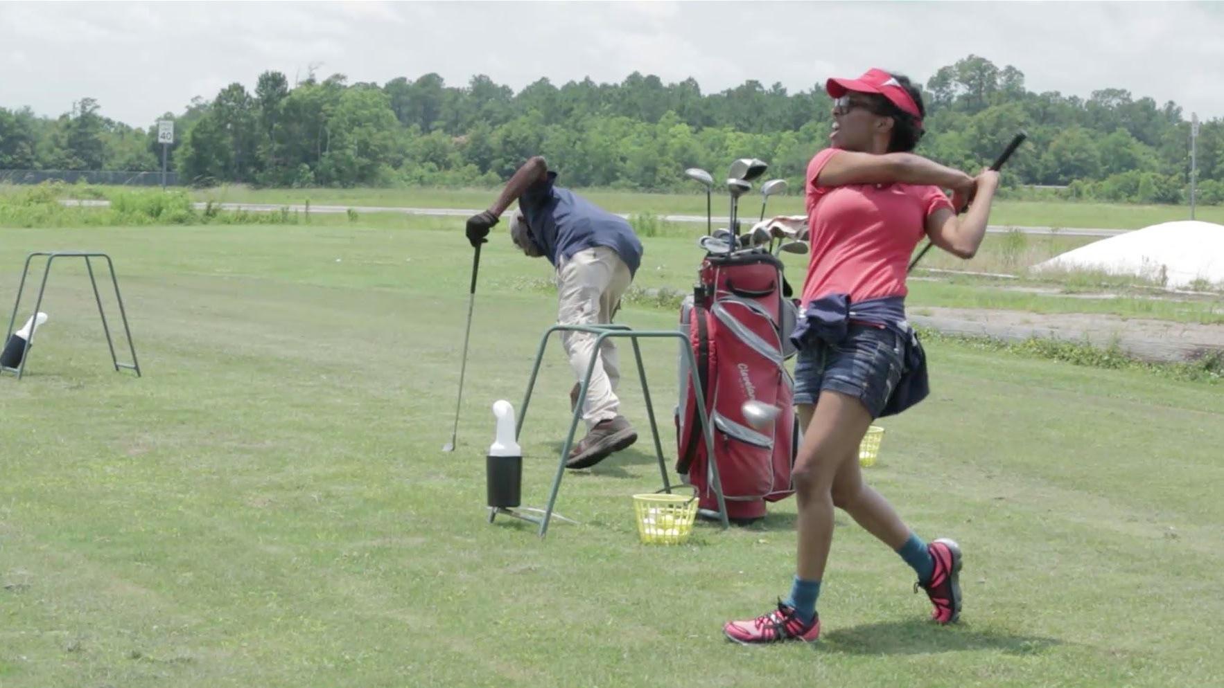 Tameka Norris playing golf