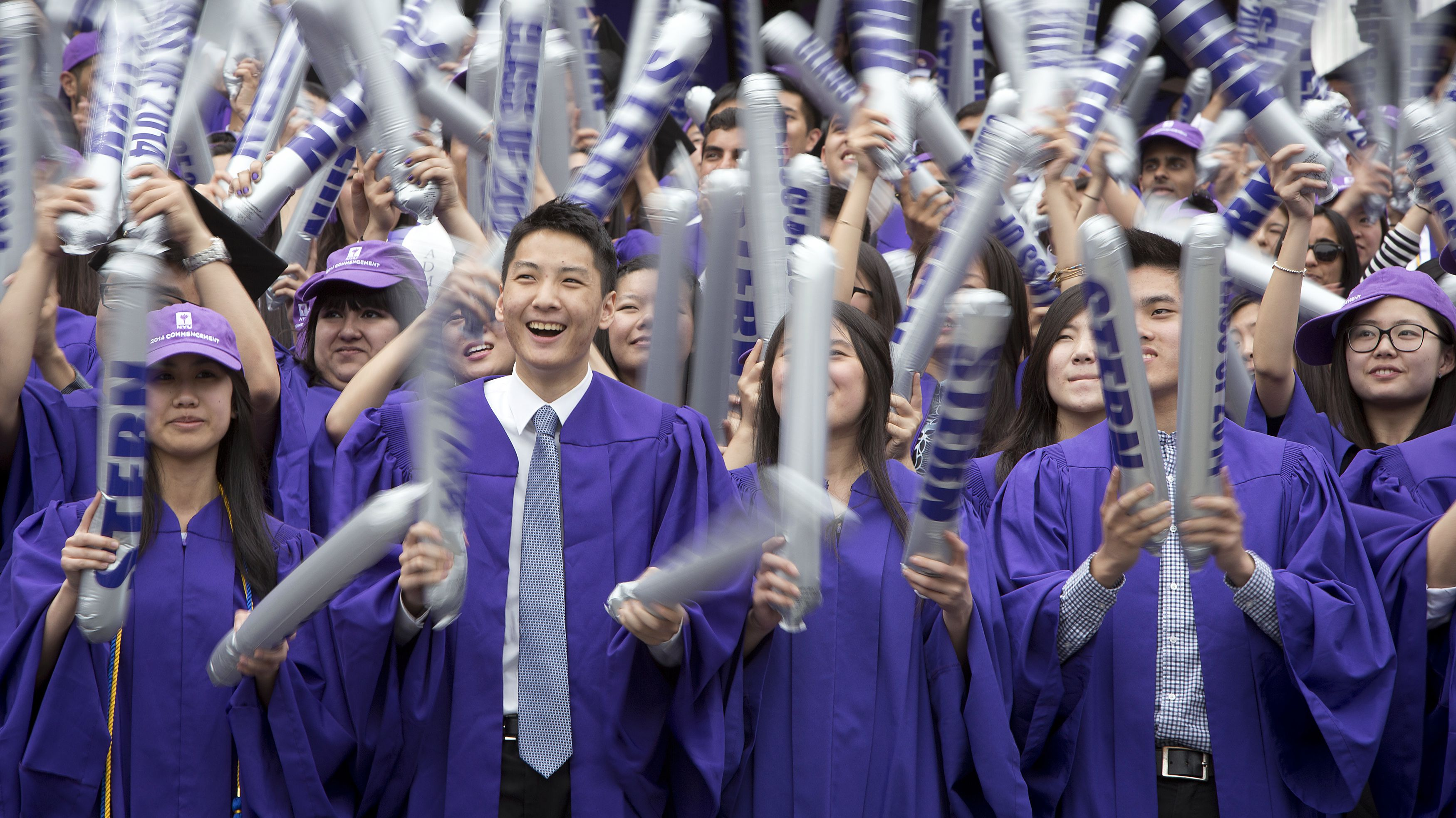 Graduates from New York University (NYU) cheer during the commencement ceremony at Yankee Stadium in the Bronx borough of New York May 21, 2014. Some 8000 NYU graduates received their degrees in the school's 182nd commencement ceremony.    REUTERS/Carlo Allegri (UNITED STATES - Tags: EDUCATION) - RTR3Q8B1
