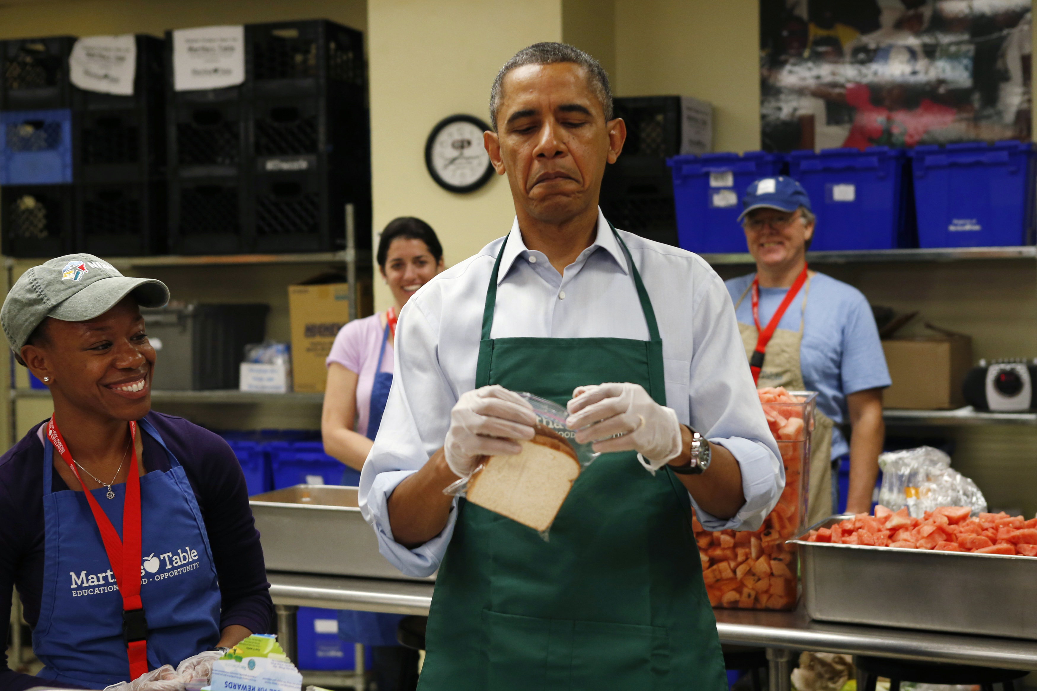 U.S. President Barack Obama during a visit to Martha's Table, a kitchen that provides meals for the needy, in Washington October 14, 2013.