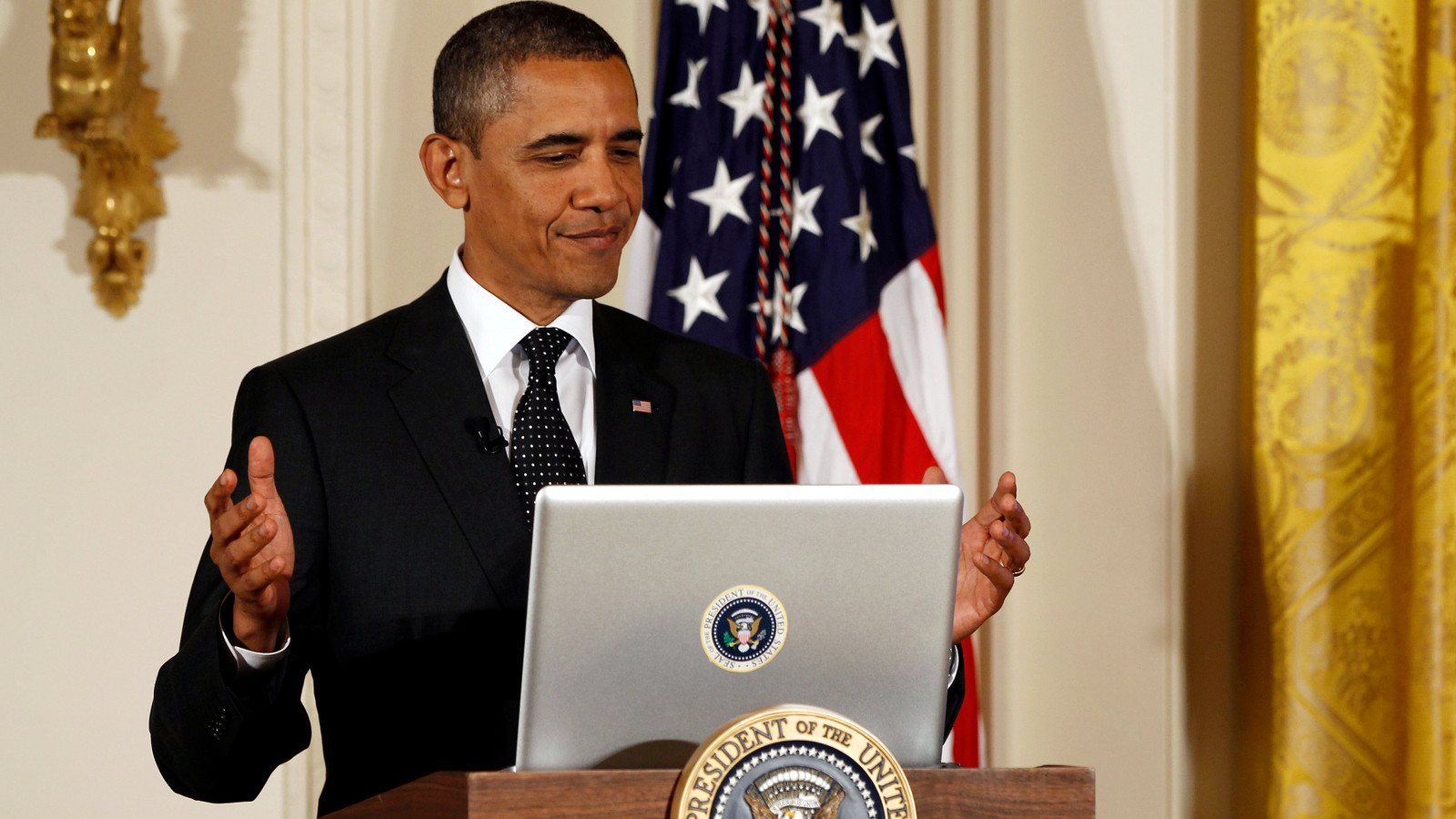 U.S. President Barack Obama reacts after tweeting at his first ever Twitter Town Hall in the East Room at the White House in Washington, July 6, 2011.