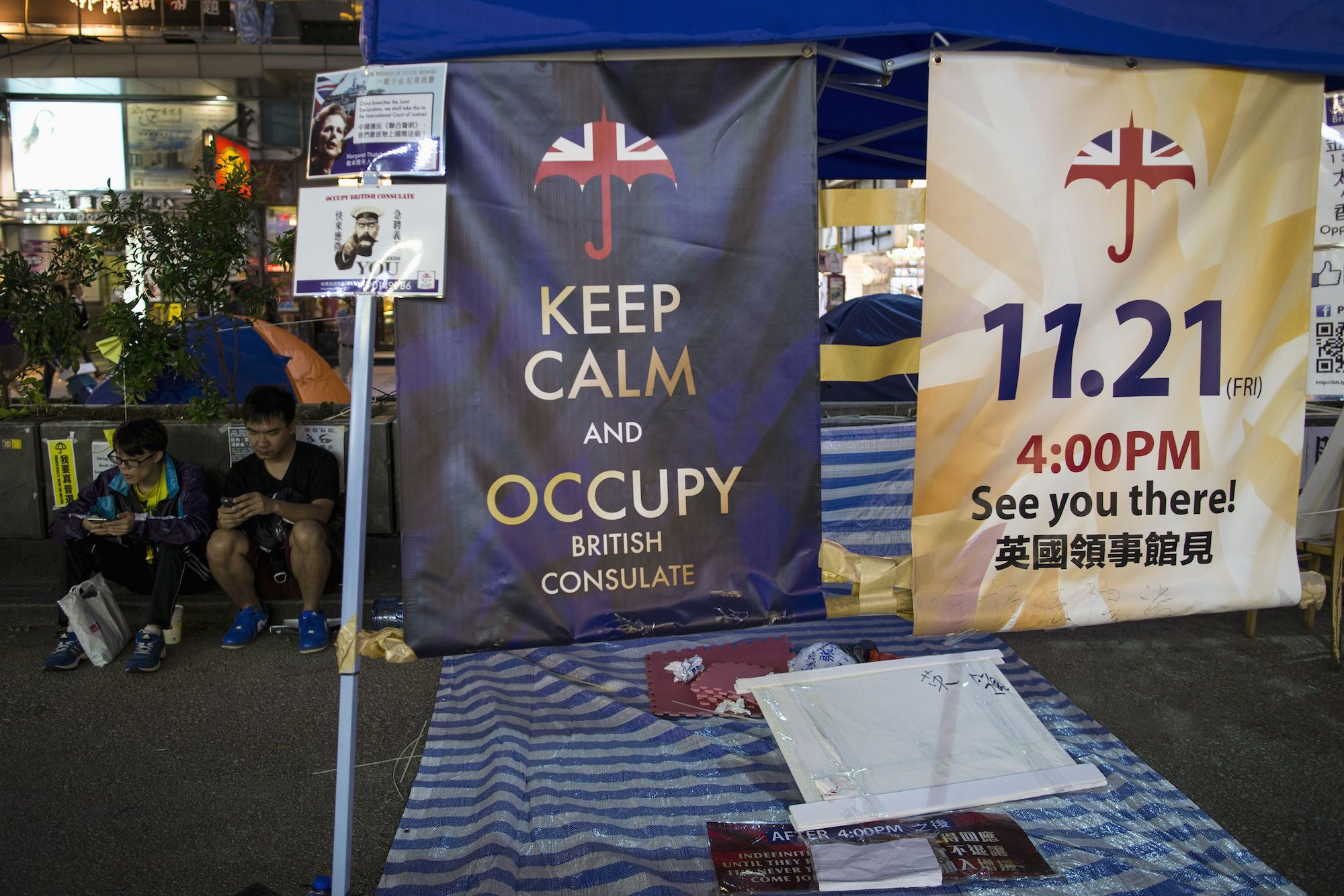 Posters appealing for people to join them for an upcoming protest, are displayed in an area protesters are occupying in Mongkok shopping district in Hong Kong November 10, 2014. Protesters say they are planning a demonstration on