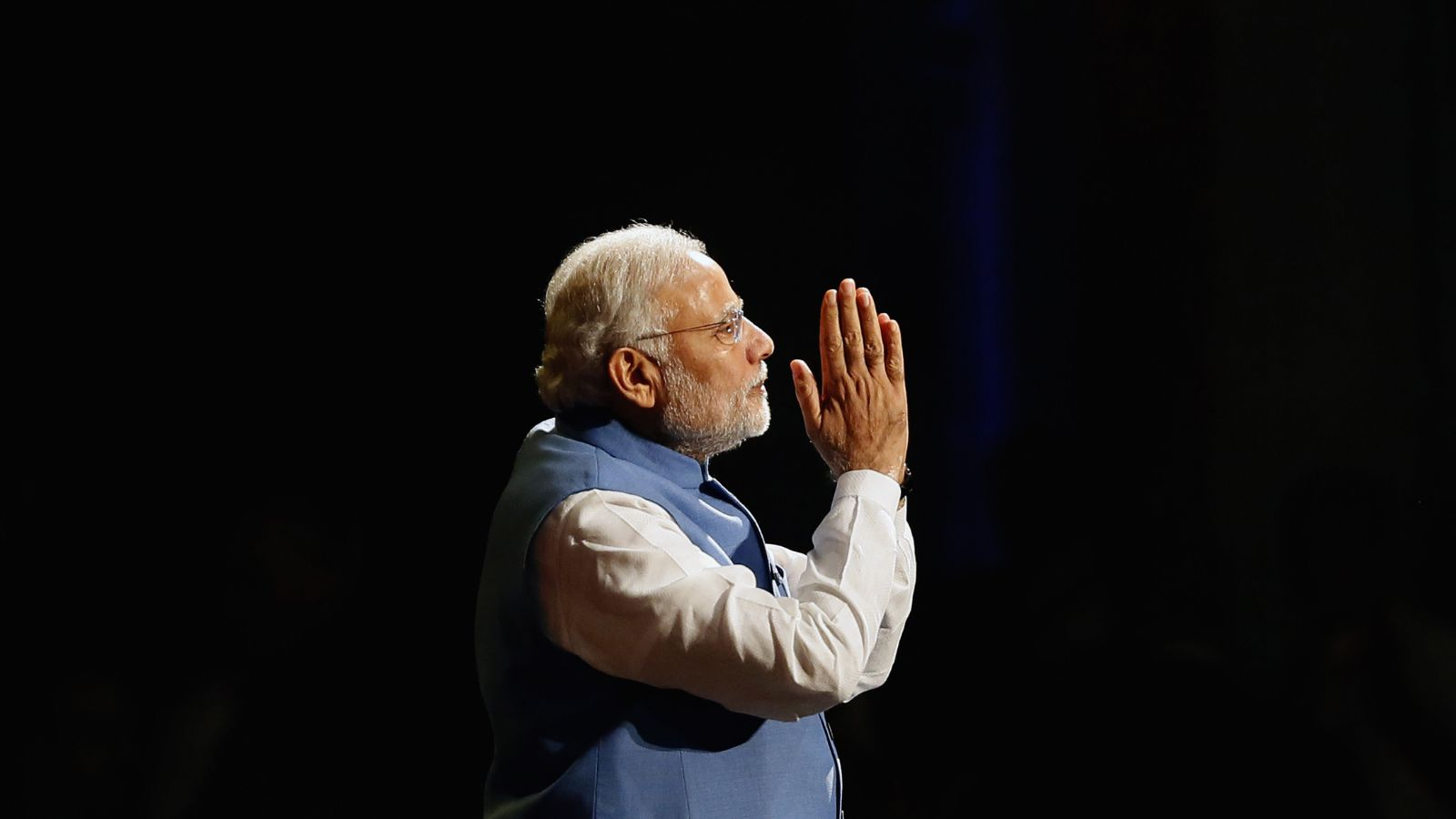 India's Prime Minister Narendra Modi reacts as he speaks to members of the Australian-Indian community during a reception at the Allphones Arena located at Sydney Olympic Park in western Sydney November 17, 2014. Modi is on a three-day offcial visit to Australia following the G20 leaders summit which was held in Brisbane over the weekend. REUTERS/Rick Stevens