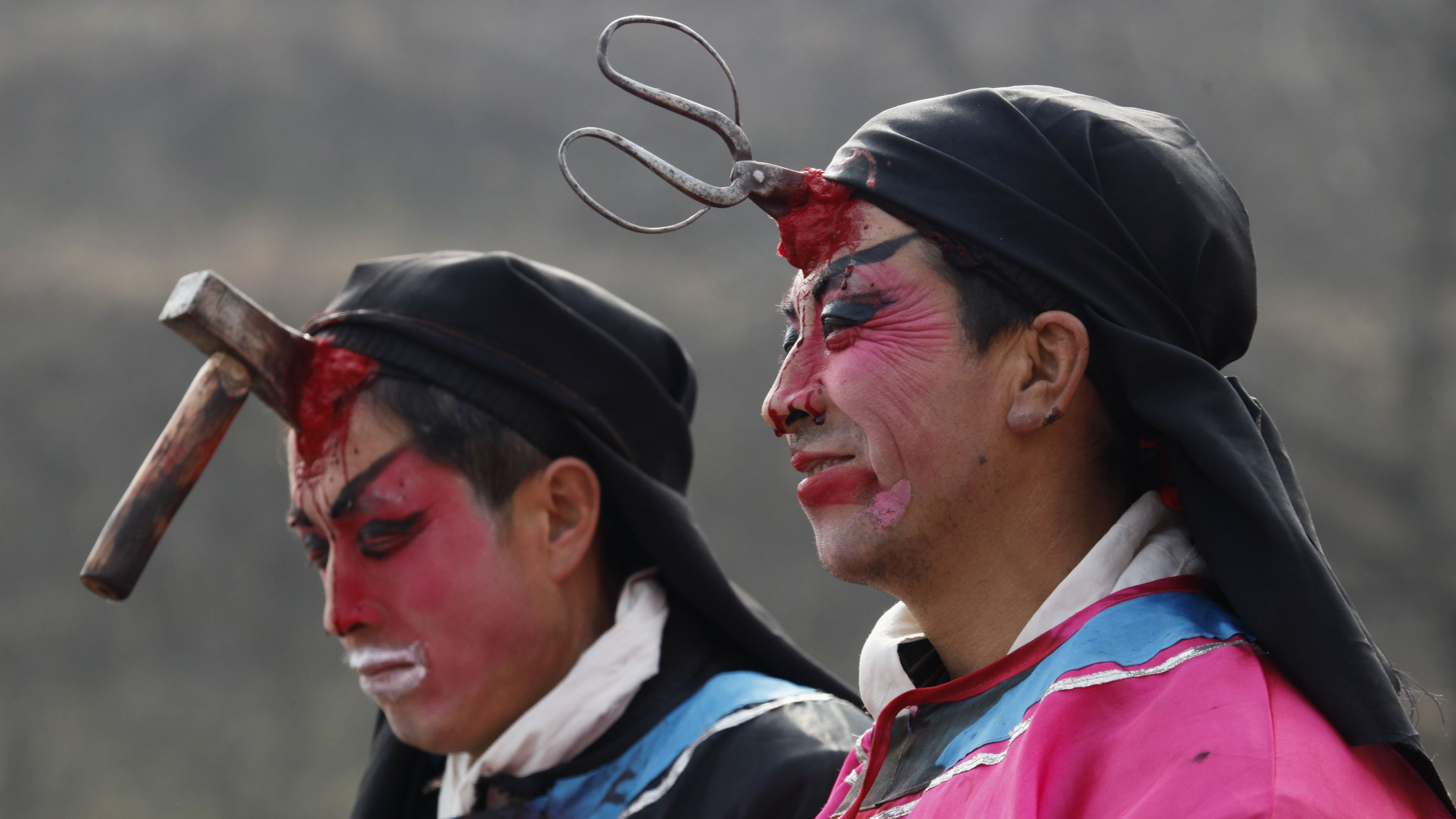 """Local performers are dressed as villains injured by an axe and a pair of scissors during a traditional """"Kuaihuo"""" parade at Chisha, Shaanxi province February 8, 2009. """"Kuaihuo"""" is a local traditional performance which originated from an ancient story about chastising villains and has been performed for over 200 years to warn people to be behave well. REUTERS/Reinhard Krause"""