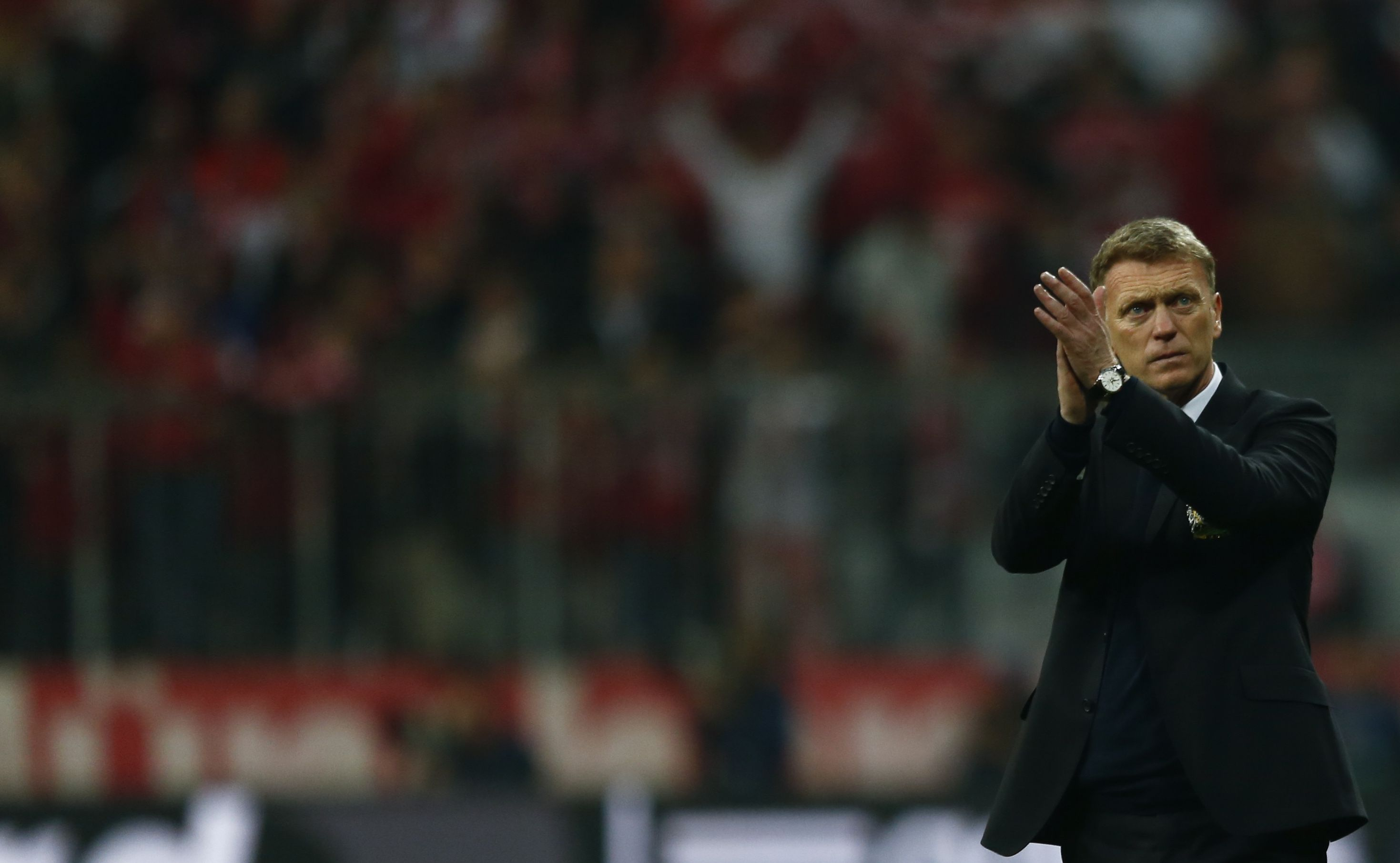 Manchester United's manager David Moyes applauds after their Champions League quarter-final second leg soccer match against Bayern Munich in Munich, April 9, 2014. REUTERS/Michael Dalder (GERMANY - Tags: SPORT SOCCER) - RTR3KMNS