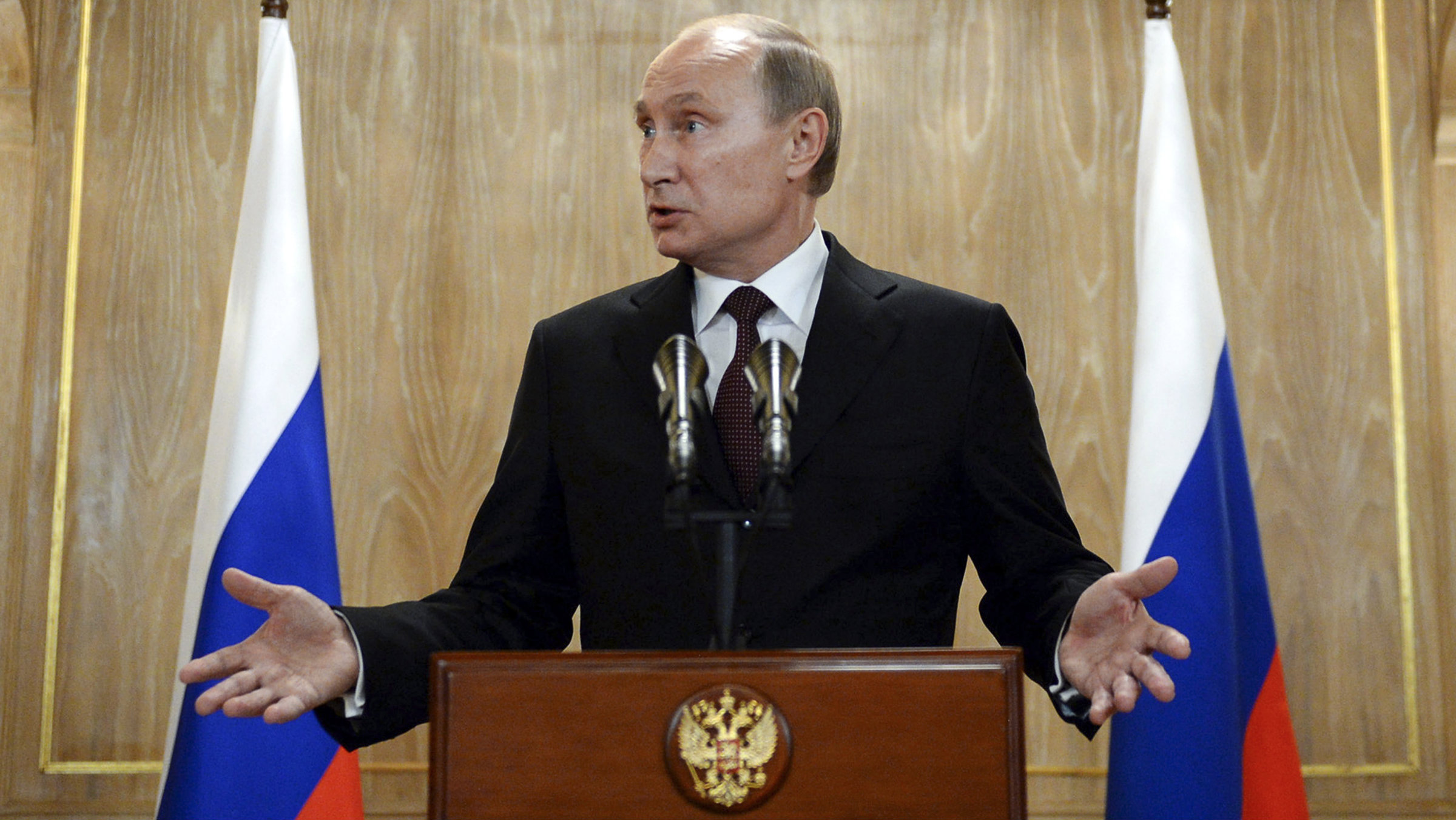 Russia's President Vladimir Putin gestures as he speaks during a news conference.