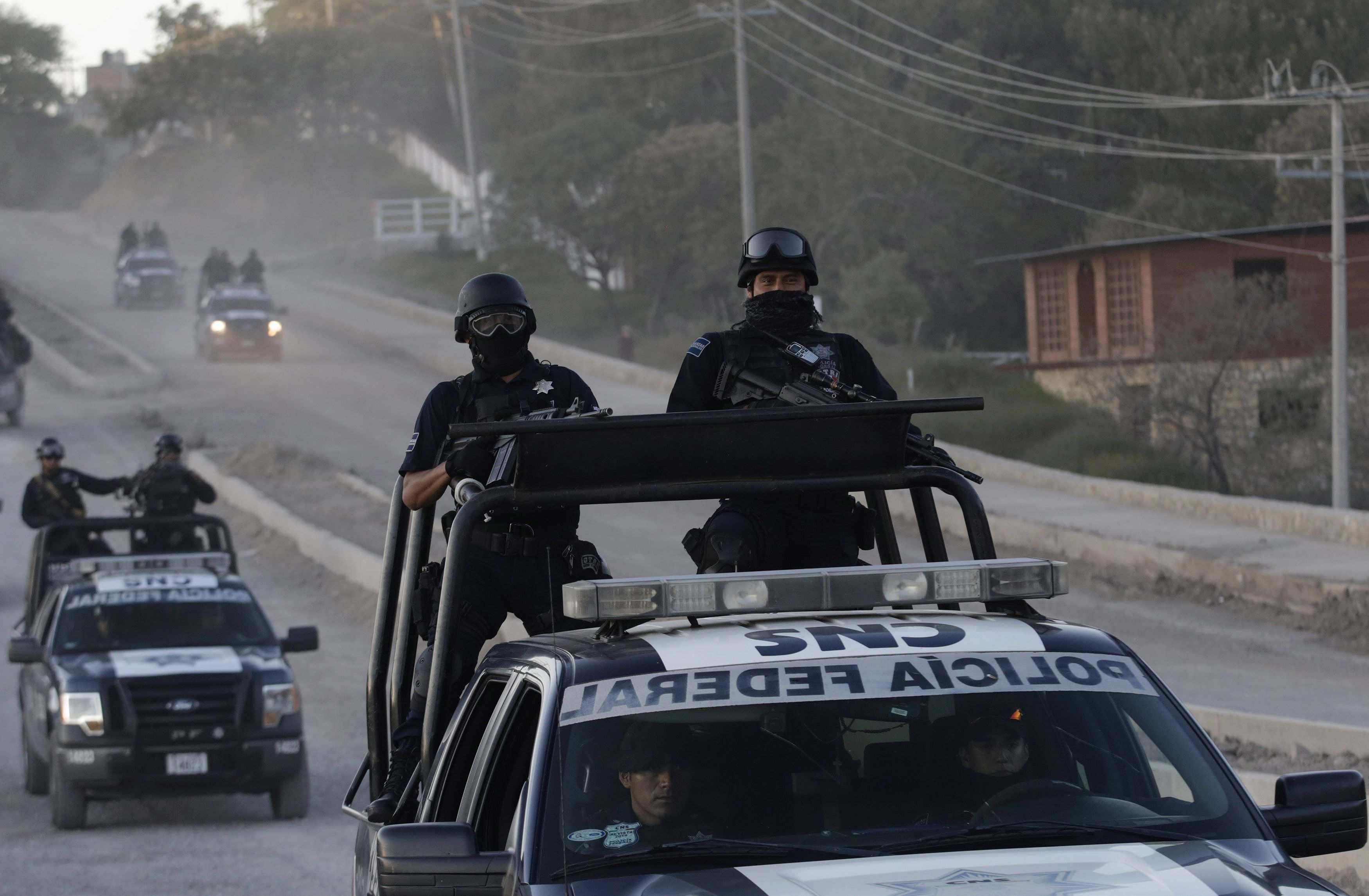 Federal police vehicles patrol Teloloapan, outside Iguala, Guerrero