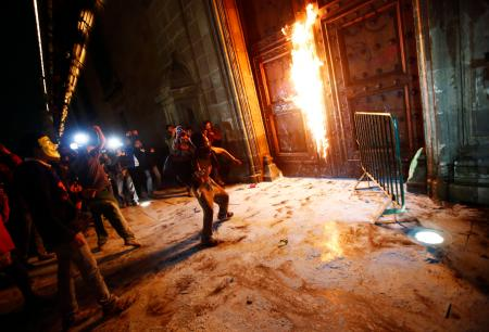 Protestors set fire to the door of the Palacio Nacional in Mexico City