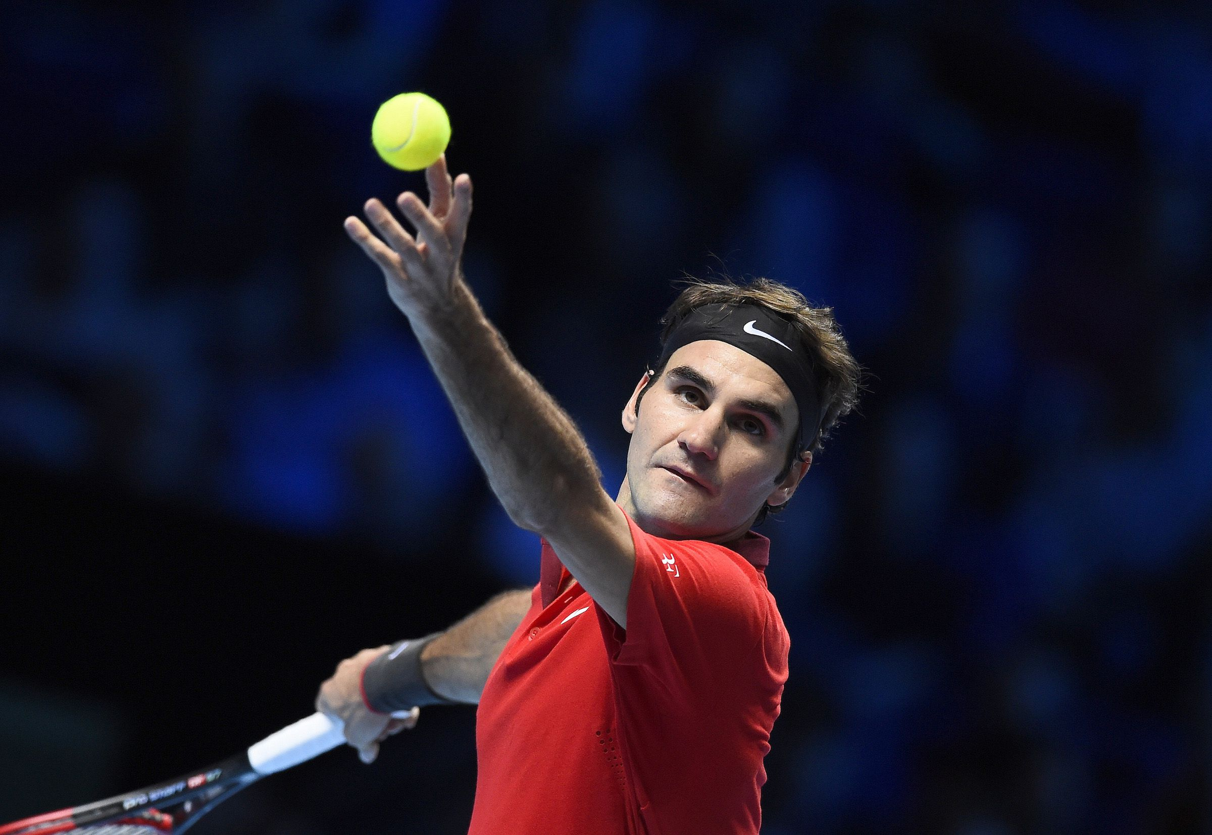 Roger Federer of Switzerland serves during his men's singles tennis match against Milos Raonic of Canada at the ATP World Tour Finals at the O2 Arena in London November 9, 2014. REUTERS/Dylan Martinez (BRITAIN - Tags: SPORT TENNIS) - RTR4DH9C