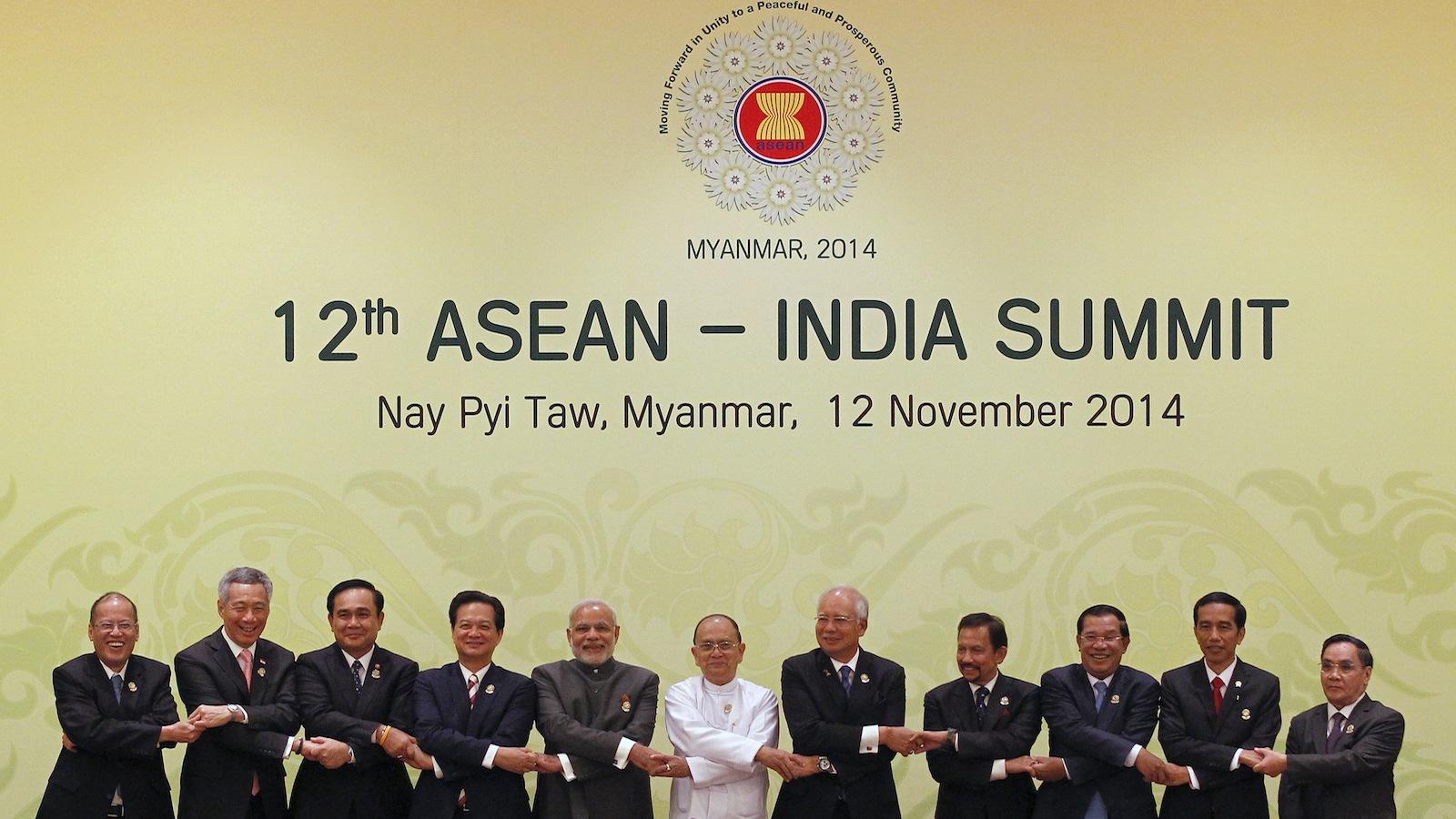 (L-R) Philippine President Benigno Aquino, Singapore's Prime Minister Lee Hsien Loong, Thailand's Prime Minister Prayuth Chan-ocha, Vietnam's Prime Minister Nguyen Tan Dung, Indian Prime Minister Narendra Modi, Myanmar's President Thein Sein, Malaysia's Prime Minister Najib Razak, Brunei's Sultan Hassanal Bolkiah, Cambodia's Prime Minister Hun Sen, Indonesia's President Joko Widodo and Laos' Prime Minister Thongsing Thammavong shake hands before the 12th ASEAN-India Summit during the 25th ASEAN Summit at the Myanmar International Convention Centre in Naypyitaw November 12, 2014. REUTERS/Soe Zeya Tun