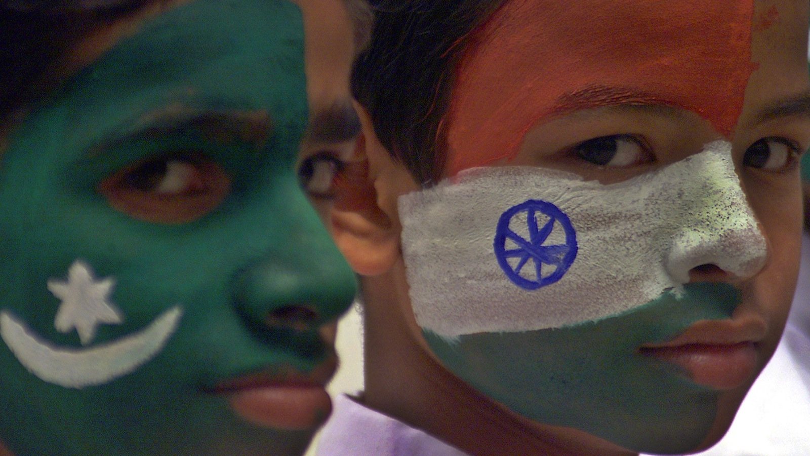 Indian students pose with India and Pakistan national flags painted on their faces in the northern Indian city of Lucknow March 7, 2005. The Pakistan team is in India on a tour to play three tests and six one-day internationals. REUTERS/Pawan Kumar VM/SD/
