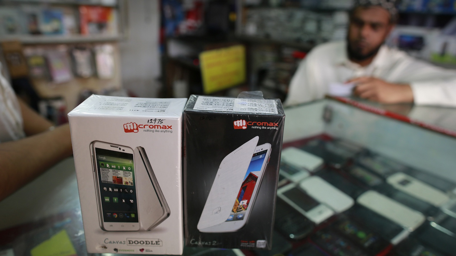 Micromax mobile phones are displayed at a mobile store in Mumbai December 4, 2013. India's Micromax, which has become the country's No. 2 smartphone brand just five years after selling its first handset - a $30 made-in-China model - is looking to go upmarket and overseas. The unlisted company sold 6.8 million phones in the July-September quarter including 2.2 million smartphones, and is on track to surpass $1 billion in sales in the fiscal year ending in March. Picture taken December 4, 2013. REUTERS/Danish Siddiqui