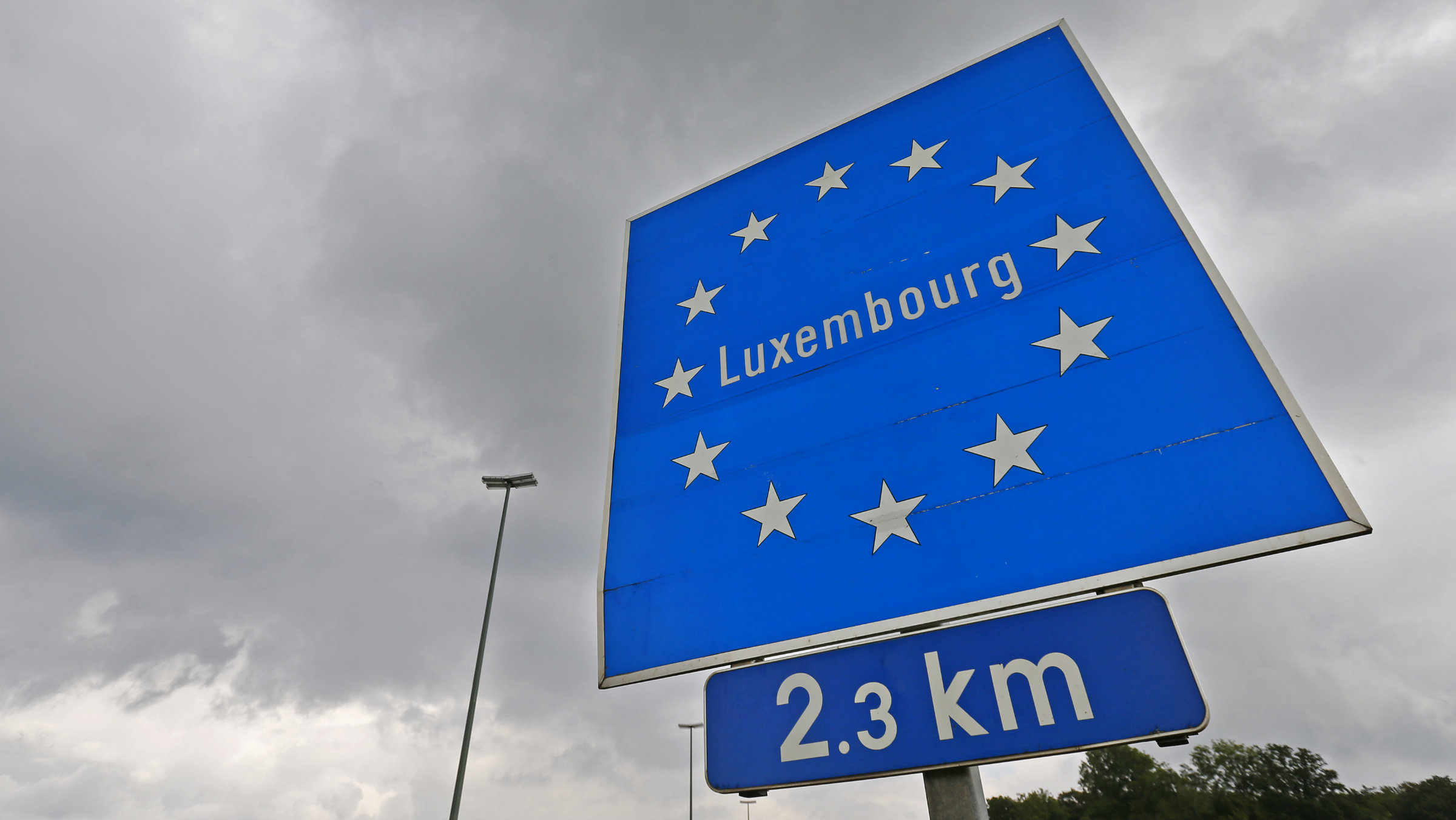 A Luxembourg road sign is seen at the border between Belgium and Luxembourg.