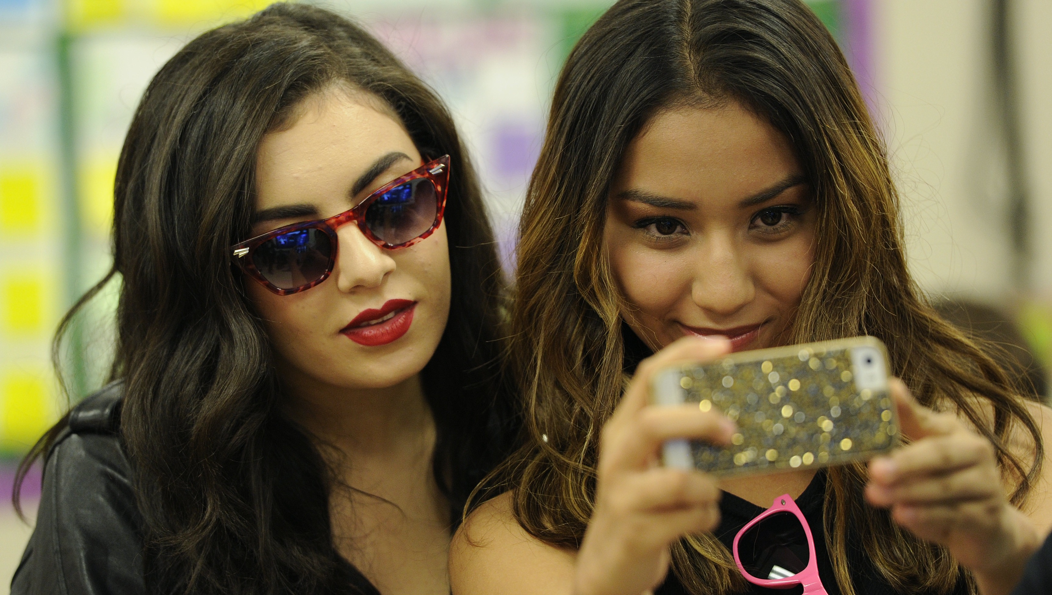 Singer Charli XCX, left, poses for a photo with Aspire Pacific Academy senior Laura Garcia during the Just Dance Homecoming at the academy on Wednesday, Oct. 22, 2014, in Huntington Park, Calif. The event celebrated the launch of the video game Just Dance 2015. (Photo by Chris Pizzello/Invision/AP)