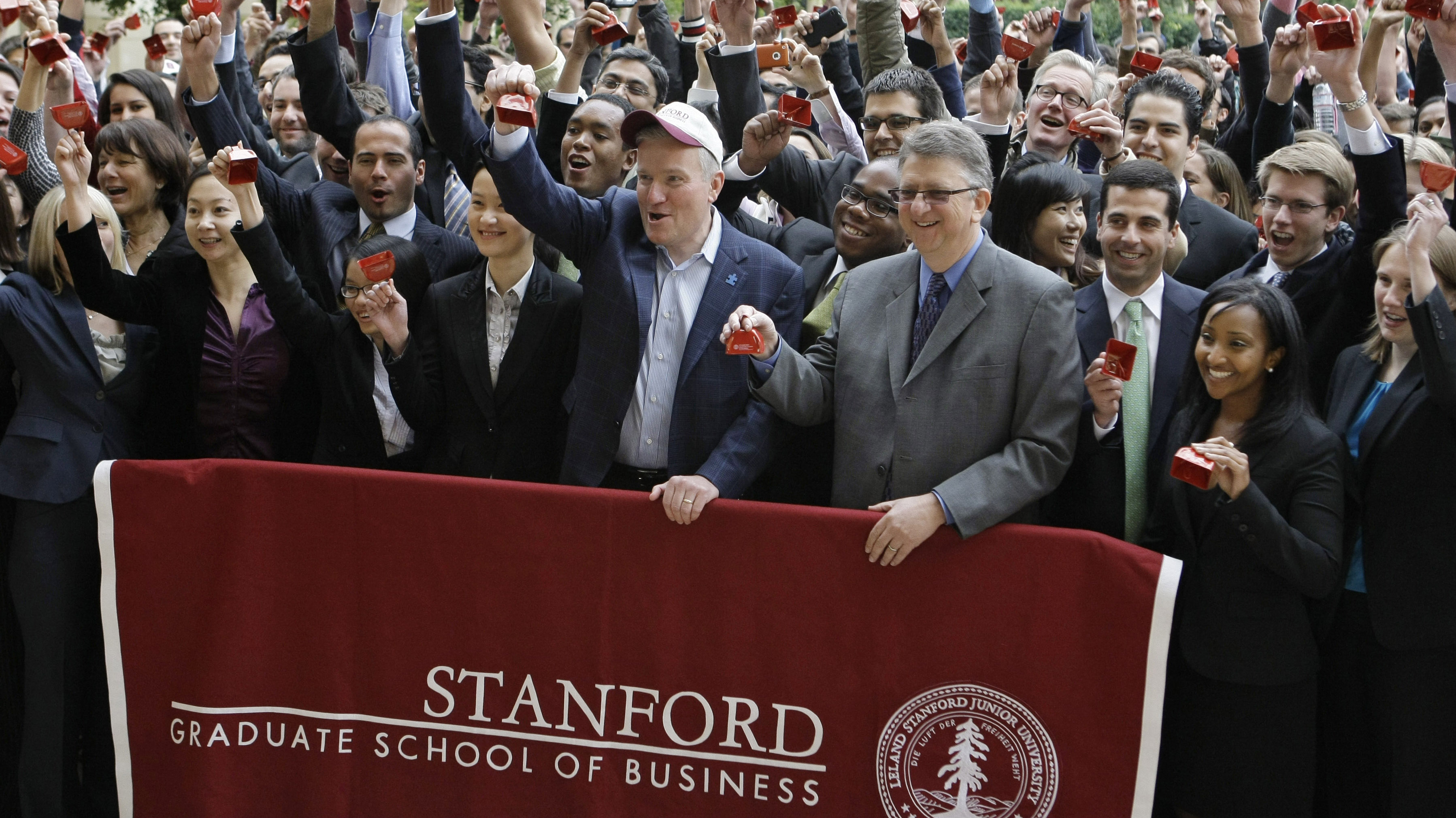 New York Stock Exchange CEO Duncan Niederauer, with hat, and Garth Saloner, Dean of the Stanford Graduate School of Business, to his right, ring the closing NYSE bell, via video teleconference, with hundreds of other Stanford MBA students on the Stanford University campus in Palo Alto, Calif., Thursday, Dec. 2, 2010.