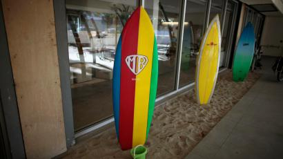 Surfboards for use by employees are lined up at the Google campus near Venice Beach, in Los Angeles, California January 13, 2012. The 100,000 square-foot campus was designed by architect Frank Gehry, and includes an entrance through an iconic pair of giant binoculars designed by Claes Oldenburg and Coosje van Bruggen. Around 500 employees develop video advertising for YouTube, parts of the Google+ social network and the Chrome Web browser at the site. REUTERS/Lucy Nicholson (UNITED STATES - Tags: SCIENCE TECHNOLOGY BUSINESS SOCIETY) - RTR2W9CL