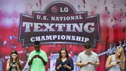 Contestants compete in the 2012 U.S. National Texting Championships in New York, August 8, 2012.