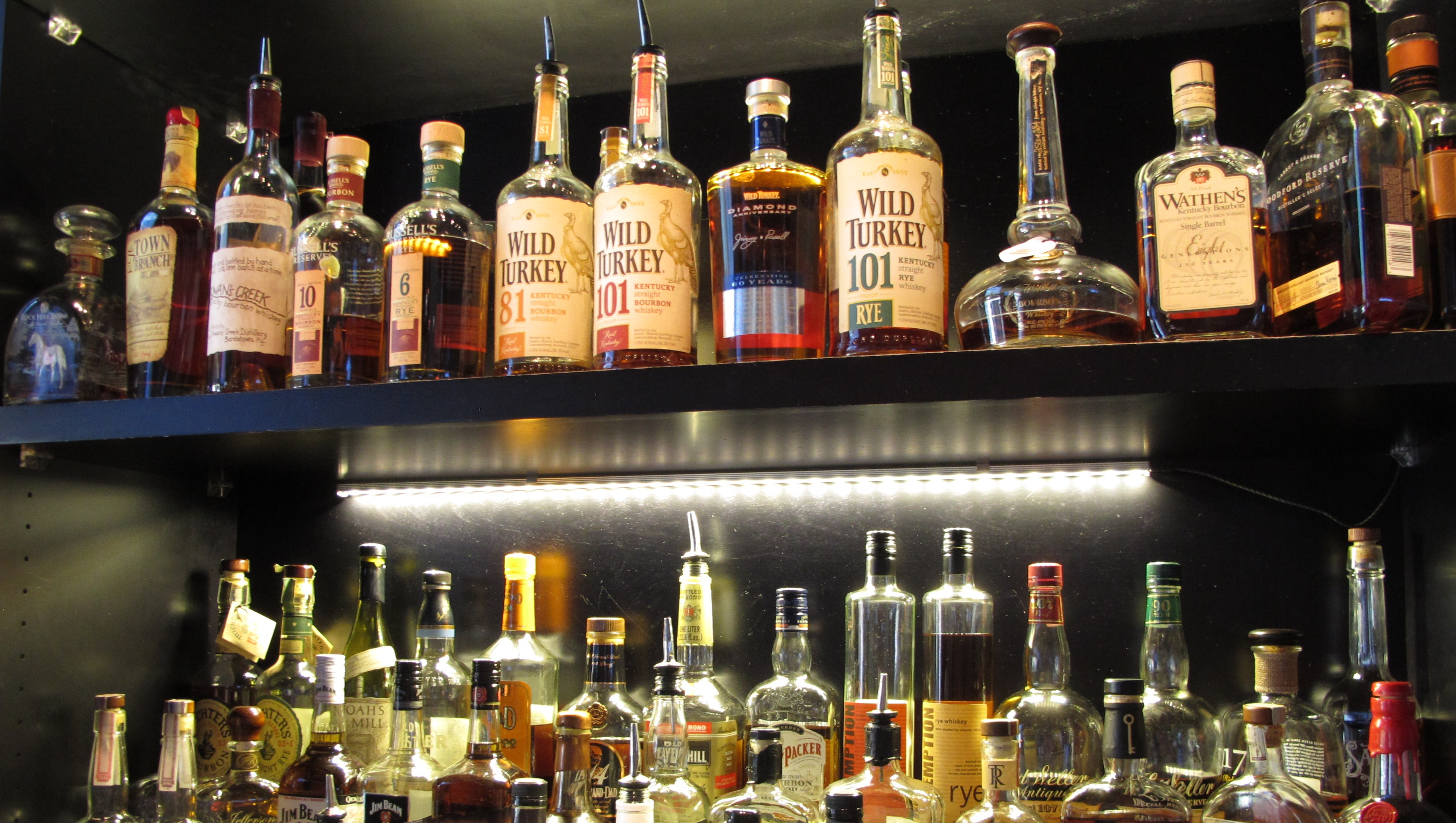 This Sept. 5, 2014 photo shows Sidebar at Whiskey Row, a bar that offers more than 100 bourbons, in the heart of downtown Louisville, Ky. Restaurants along the city's Urban Bourbon Trail are routinely stocked with 50 to 150 varieties of Kentucky's signature spirit. (AP Photo/Bruce Schreiner)