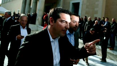 Alexis Tsipras, opposition leader and head of radical leftist Syriza party, leaves the parliament building after the last round of a presidential vote in Athens December 29, 2014. Greek Prime Minister Antonis Samaras said he would propose holding an early national election on Jan. 25 after parliament rejected his nominee for president.