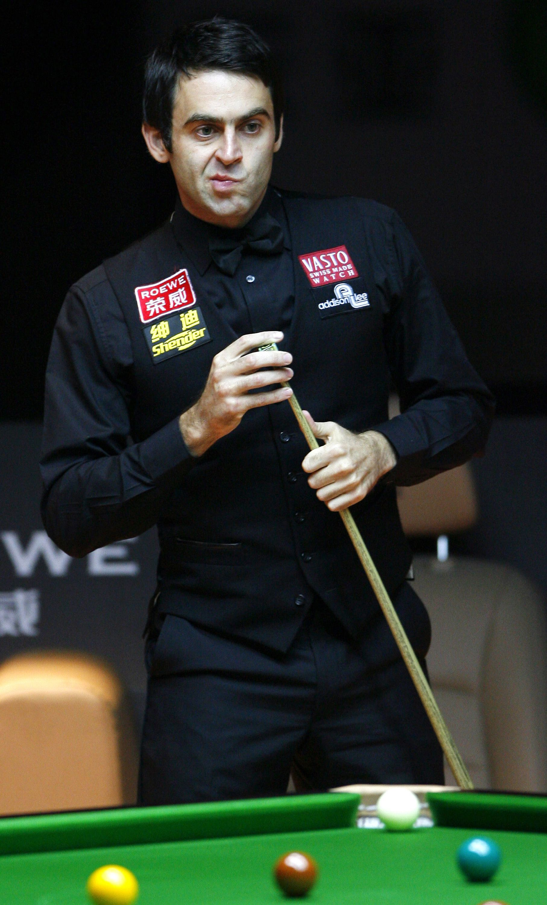 In this photo released by China's Xinhua News Agency, Ronnie O'Sullivan of England reacts during the final against his compatriot Ricky Walden in the 2008 World Snooker Roewe Shanghai Masters in east China's Shanghai, Sunday, Oct. 5, 2008. Qualifier Walden upset world champion O'Sullivan 10-8. (AP Photo/Xinhua, Fan Jun)