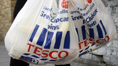 Tesco shopping bags are carried in London,.