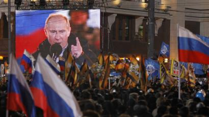 People rally in support of Russian Prime Minister and presidential candidate Vladimir Putin in Moscow, Sunday, March 4, 2012.