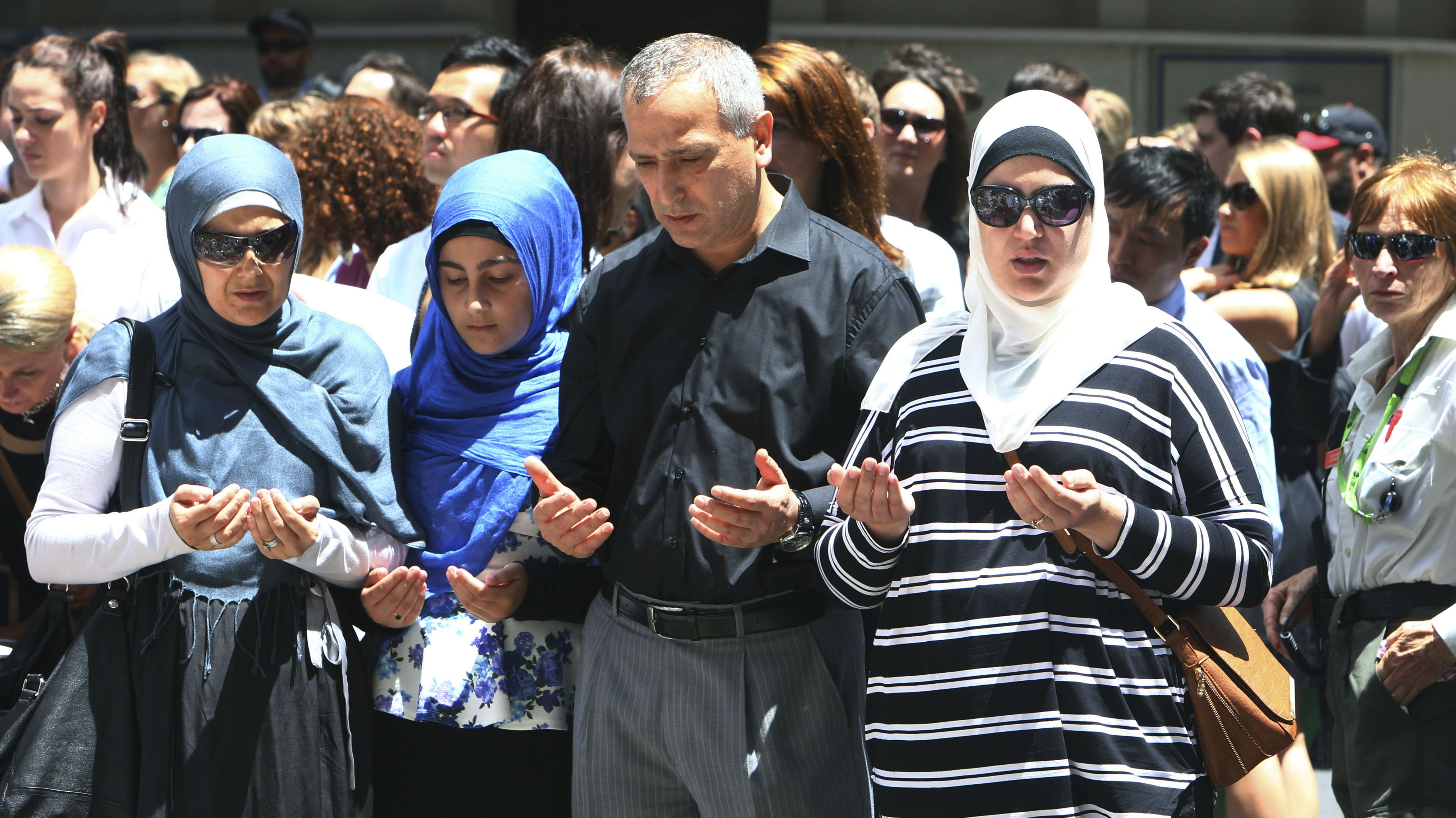 Muslims pray for the victims of the siege