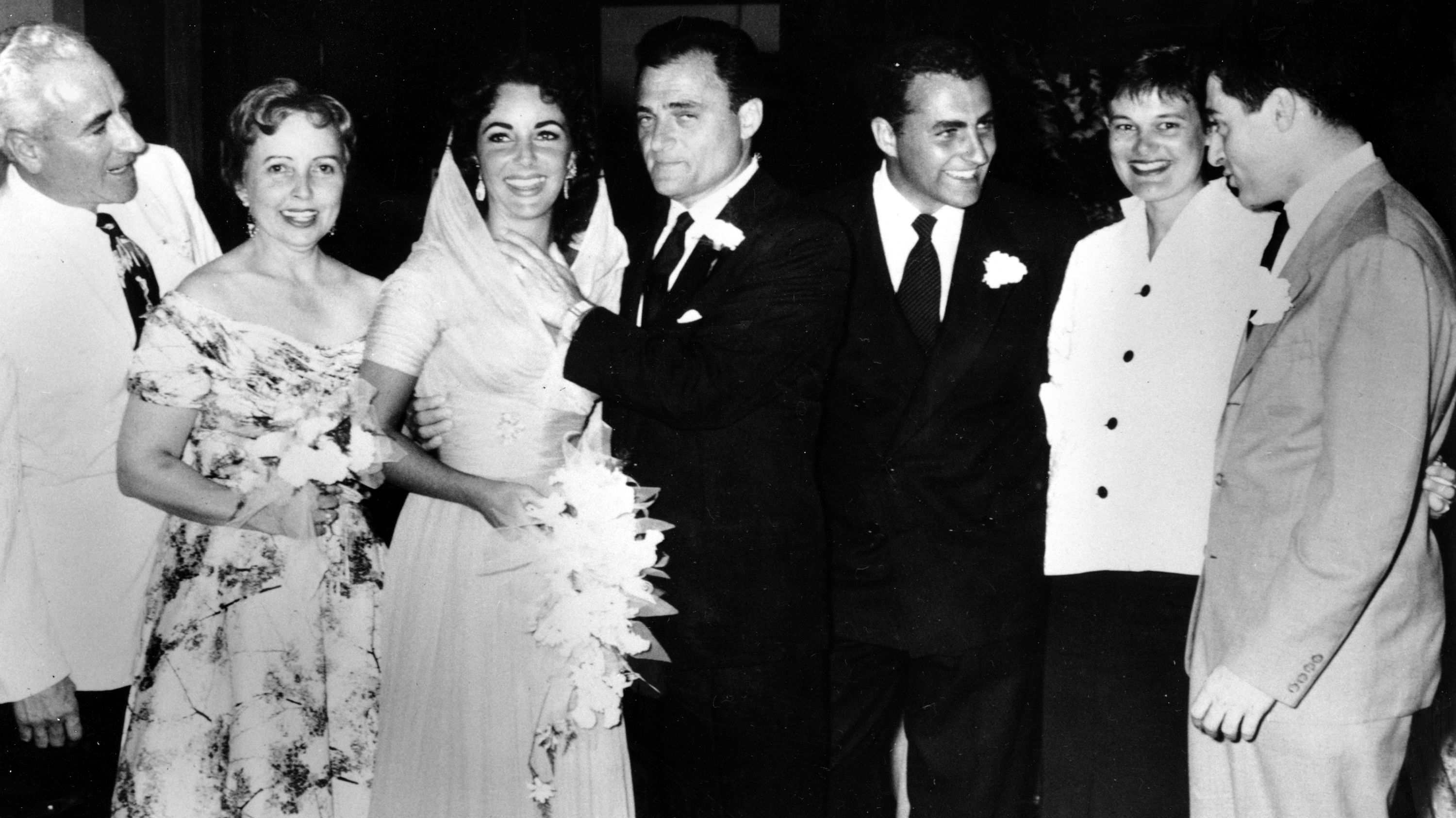 Actress Elizabeth Taylor and film producer Michael Todd pose with their family after their wedding in Acapulco, Mexico on Feb. 3, 1957. From left to right are, Mr. and Mrs. Francis Taylor, her parents; Taylor and Todd; her brother Howard Taylor and his wife; and Mike Todd, Jr. (AP Photo)
