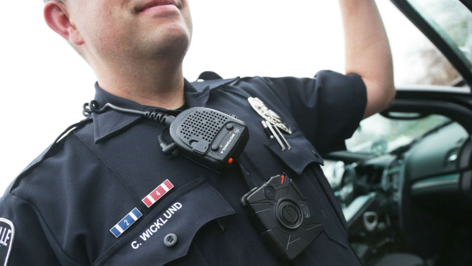 In this Nov. 5, 2014 photo, Sgt. Chris Wicklund of the Burnsville Police Department wears a body camera beneath his microphone.