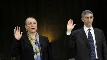 Irene Dorner, president and chief executive officer of HSBC Bank USA, N.A. and HSBC North America Holdings, Inc., left, and Stuart A. Levey, chief legal officer of HSBC Holdings plc, are sworn in before testifying before the permanent Subcommittee on Investigations, July 17, 2012.