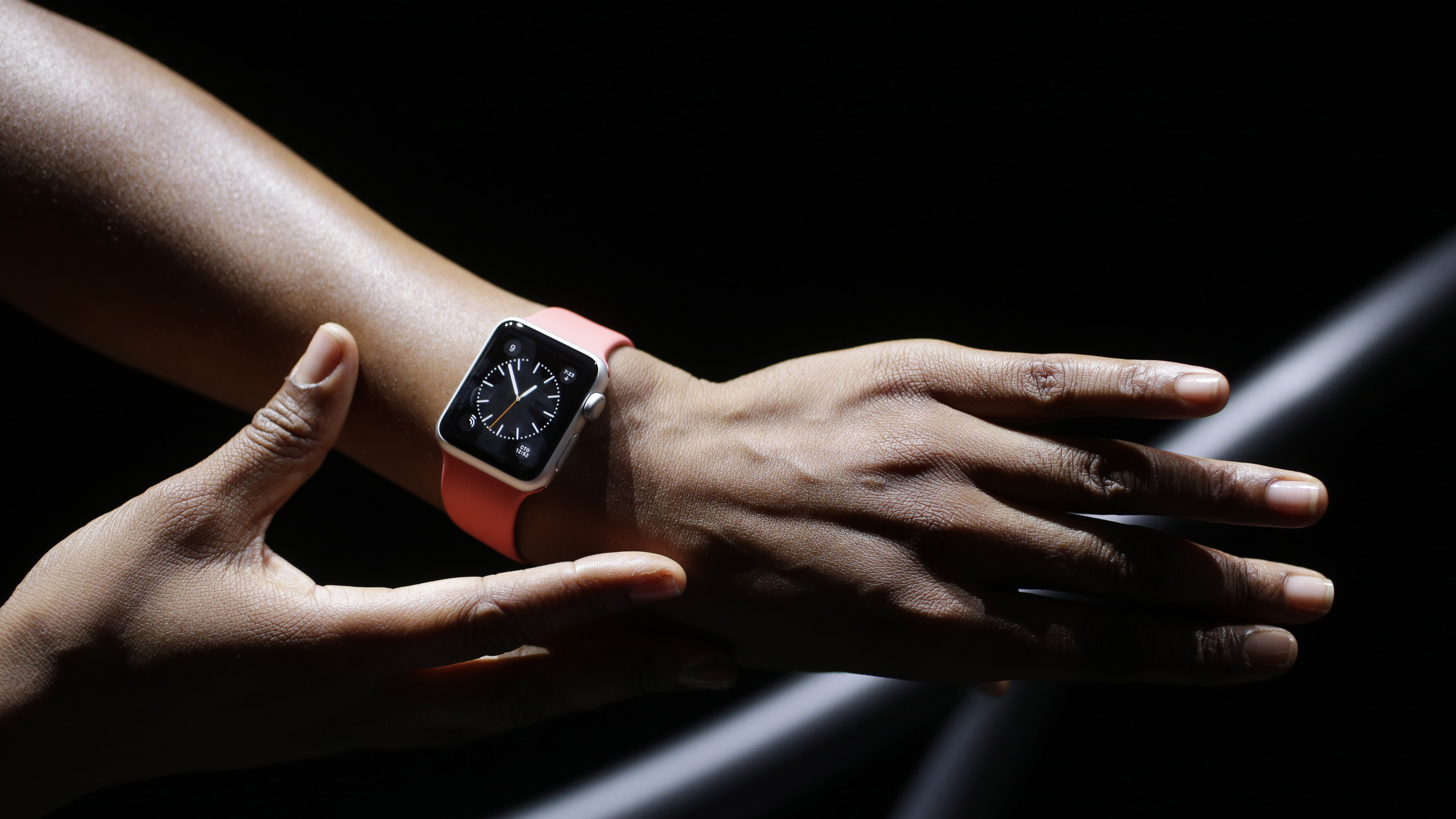 The new Apple Watch is shown by a model on a treadmill during a new product release on Tuesday, Sept. 9, 2014, in Cupertino, Calif. (AP Photo/Marcio Jose Sanchez)