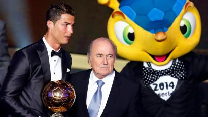 Portugal's Cristiano Ronaldo poses with FIFA President Sepp Blatter (C) and 2014 World Cup mascot Fuleco after being awarded the FIFA Ballon d'Or 2013 in Zurich January 13, 2014. Portugal and Real Madrid forward Cristiano Ronaldo was named the world's best footballer for the second time on Monday, preventing his great rival Lionel Messi from winning the award for a fifth year in a row.
