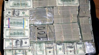 A haul of about 206 million U.S. dollars is seen after it was found stashed in closets, suitcases, and drawers in a house in an upscale neighbourhood of Mexico City March 15, 2007. law enforcement officials said the money belonged to drugs smugglers who imported chemicals used to make methamphetamines. Seven people were arrested in the raid. Picture taken March 15, 2007. QUALITY FROM SOURCE