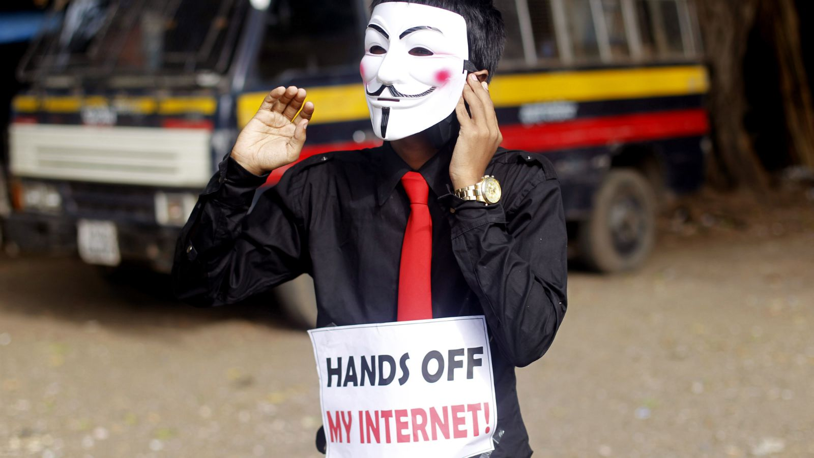 A member of a hacking group, Anonymous India, wears Guy Fawkes mask as he protests against Indian government enacted laws that gives it power to censor different aspects of Internet usage, in Mumbai, India, Saturday, June 9, 2012. The Indian hacker group is a spinoff of Anonymous, an amorphous group of activists, hackers and pranksters whose past targets have included Visa and MasterCard.