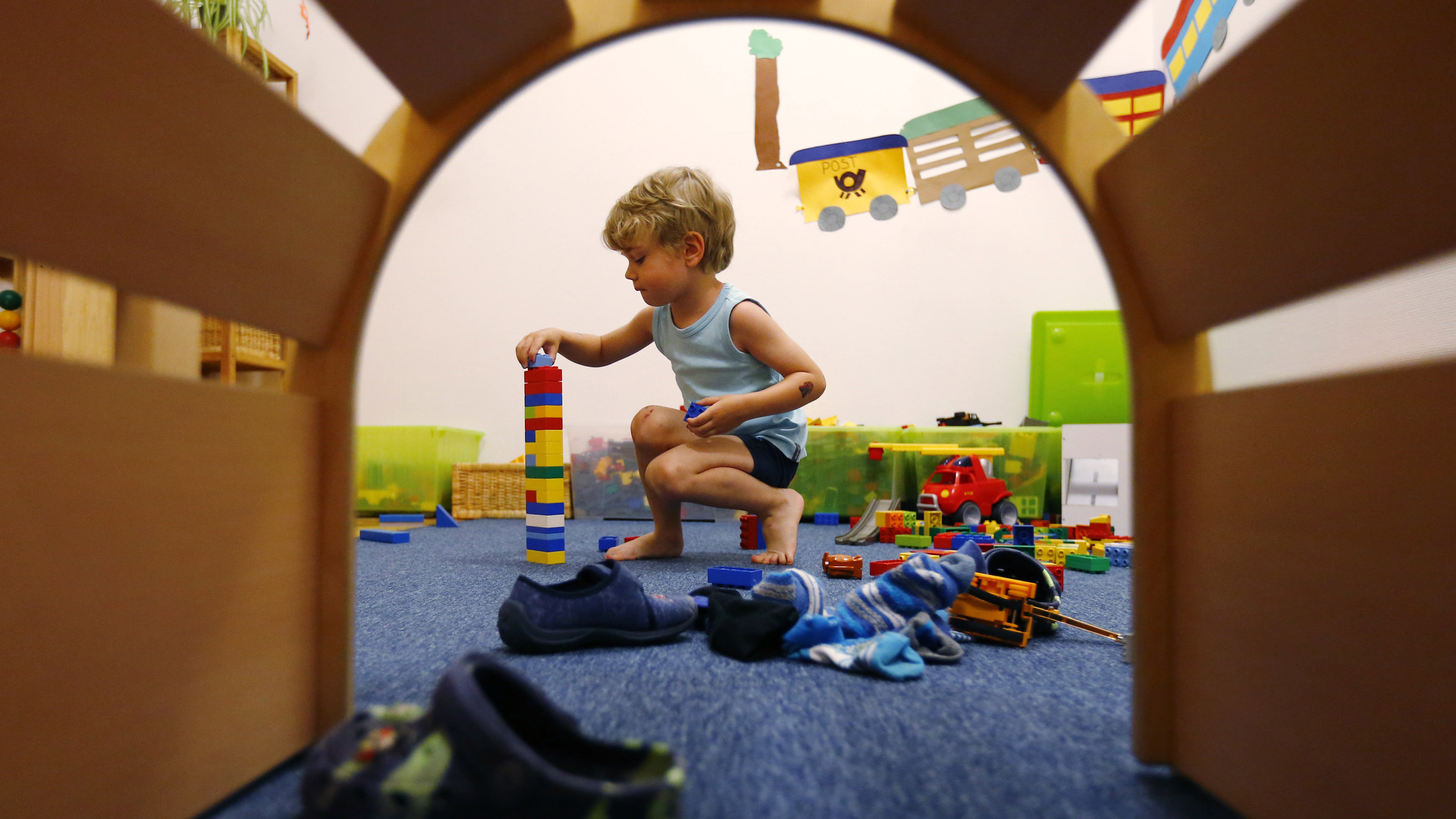 A four year-old boy plays at the Kathinka-Platzhoff-Stiftung Kindergarten (Kathinka-Platzhoff-foundation kindergarden) in Hanau, 30km (18 miles) south of Frankfurt, July 16, 2013. From August 1, 2013, all children in Germany between the age of 1 and 3 will have a legal entitlement to a place at a kindergarten. The Kindergarten of the Kathinka-Platzhoff-Stiftung is one of few which hosts children between the age of six month and six years. Picture taken July 16. REUTERS/Kai Pfaffenbach