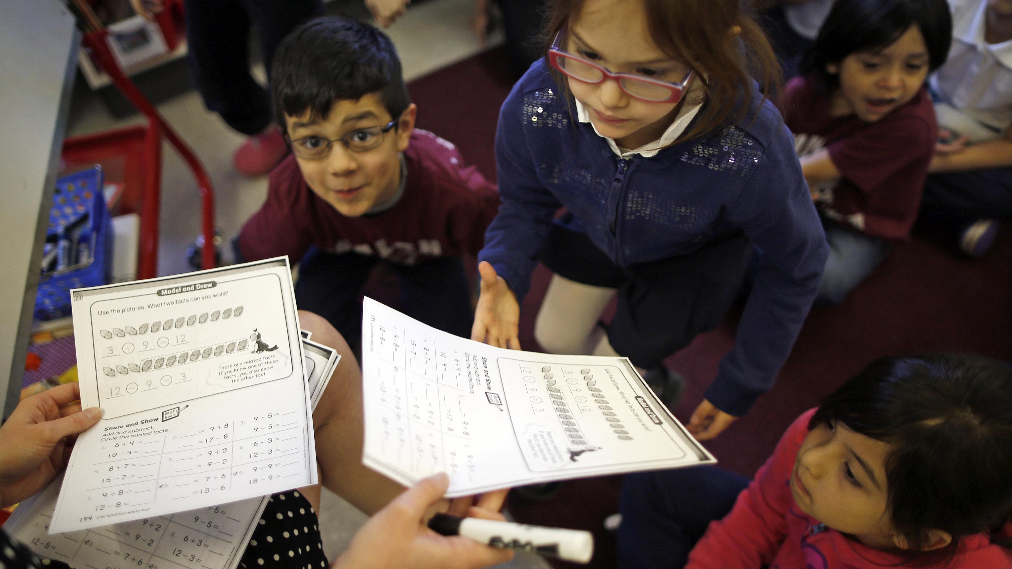 children being given worksheets