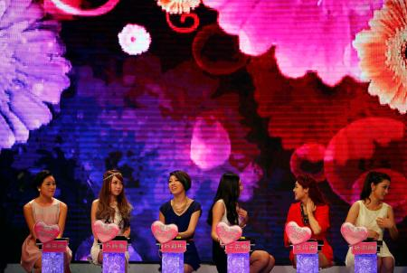 Woman talk during the recording of an episode of a matchmaking television programme,