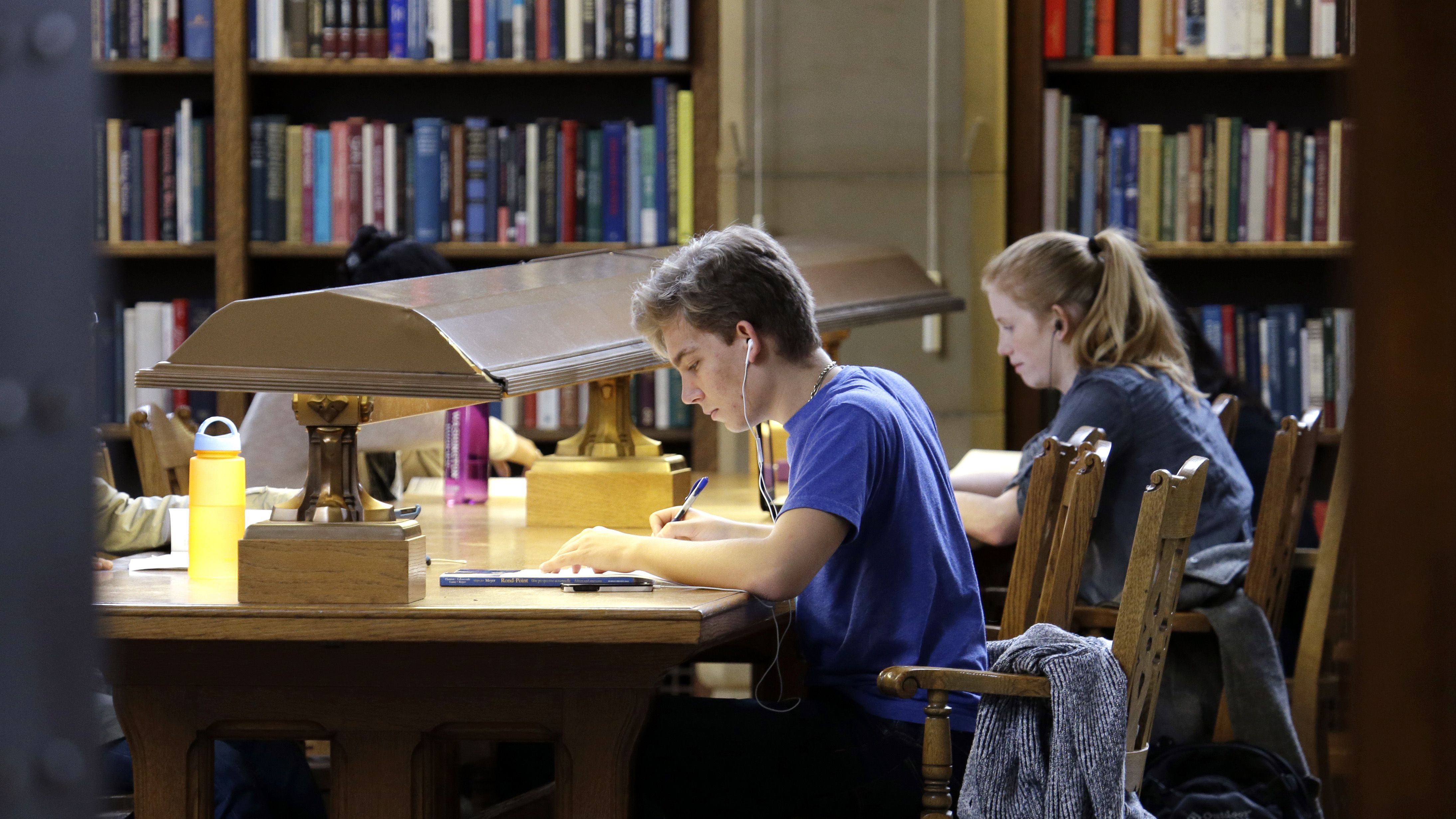 In this photo taken Tuesday, Oct. 15, 2013, University of Washington students study in Odegaard Library on the campus in Seattle. As Washington's prepaid tuition program opens its doors to new investors Friday, Oct. 31, 2013, parents may wonder if it's a good way to save for college.The answer depends on the age of your children, your family's financial situation and some unknown factors such as how much tuition will go up in the future, inflation and the stock market. (AP Photo/Elaine Thompson)