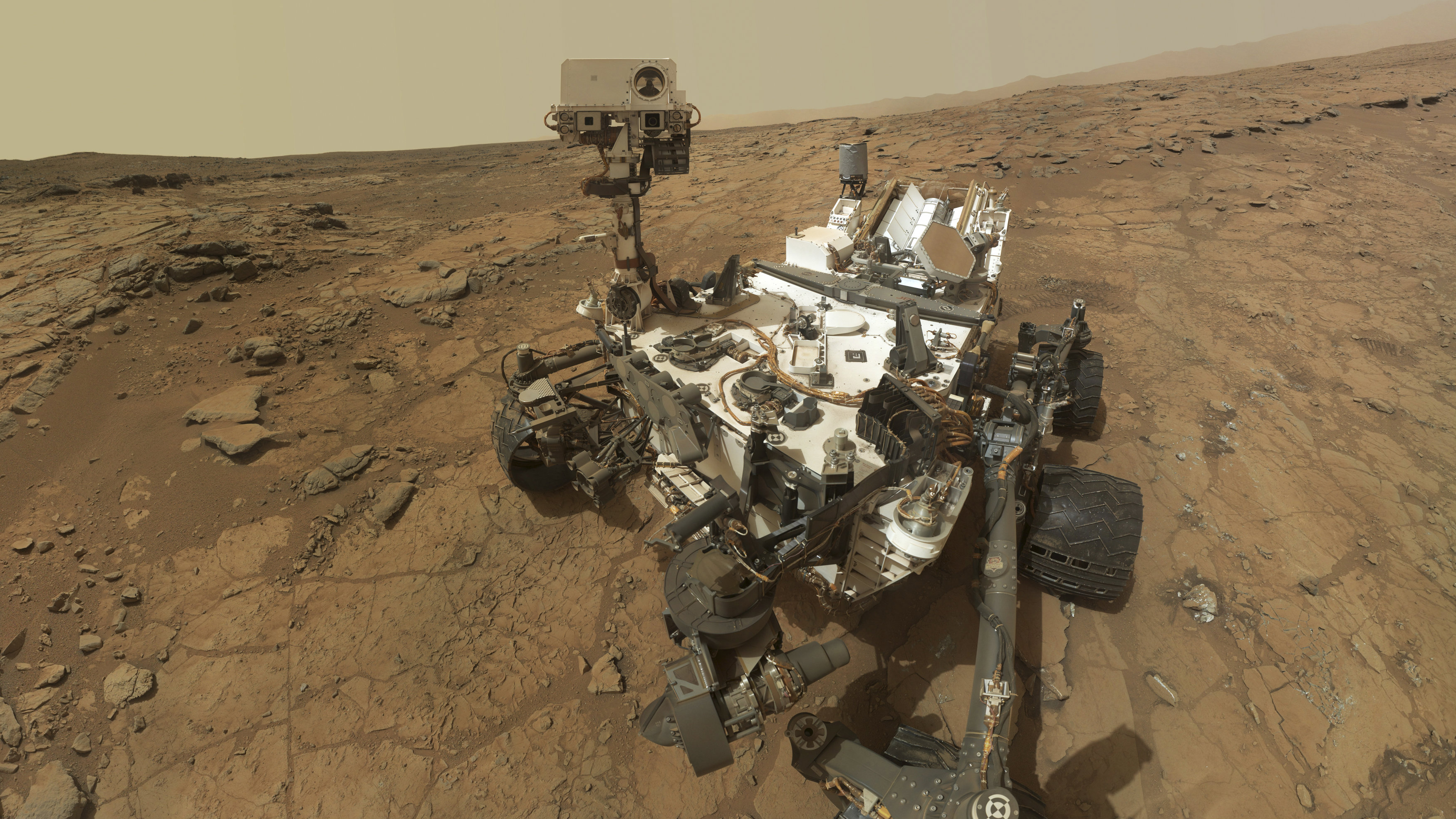 """Self-portrait of the rover Curiosity, combining dozens of exposures taken by the rover's Mars Hand Lens Imager (MAHLI) during the 177th Martian day, or sol, is seen in this February 3, 2013 handout image courtesy of NASA. The rover is positioned at a patch of flat outcrop called """"John Klein,"""" which was selected as the site for the first rock-drilling activities by Curiosity. The rover's robotic arm is not visible in the mosaic."""