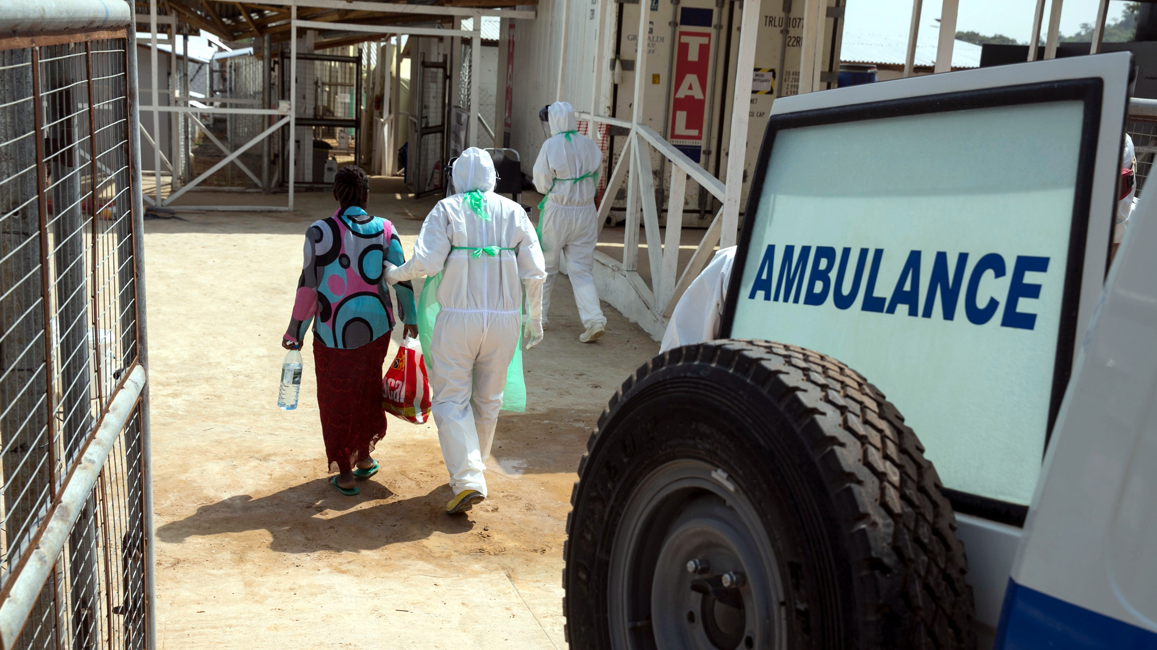 A health worker escorts a newly admitted Ebola patient in to the Kerry town Ebola treatment centre outside Freetown December 22, 2014.
