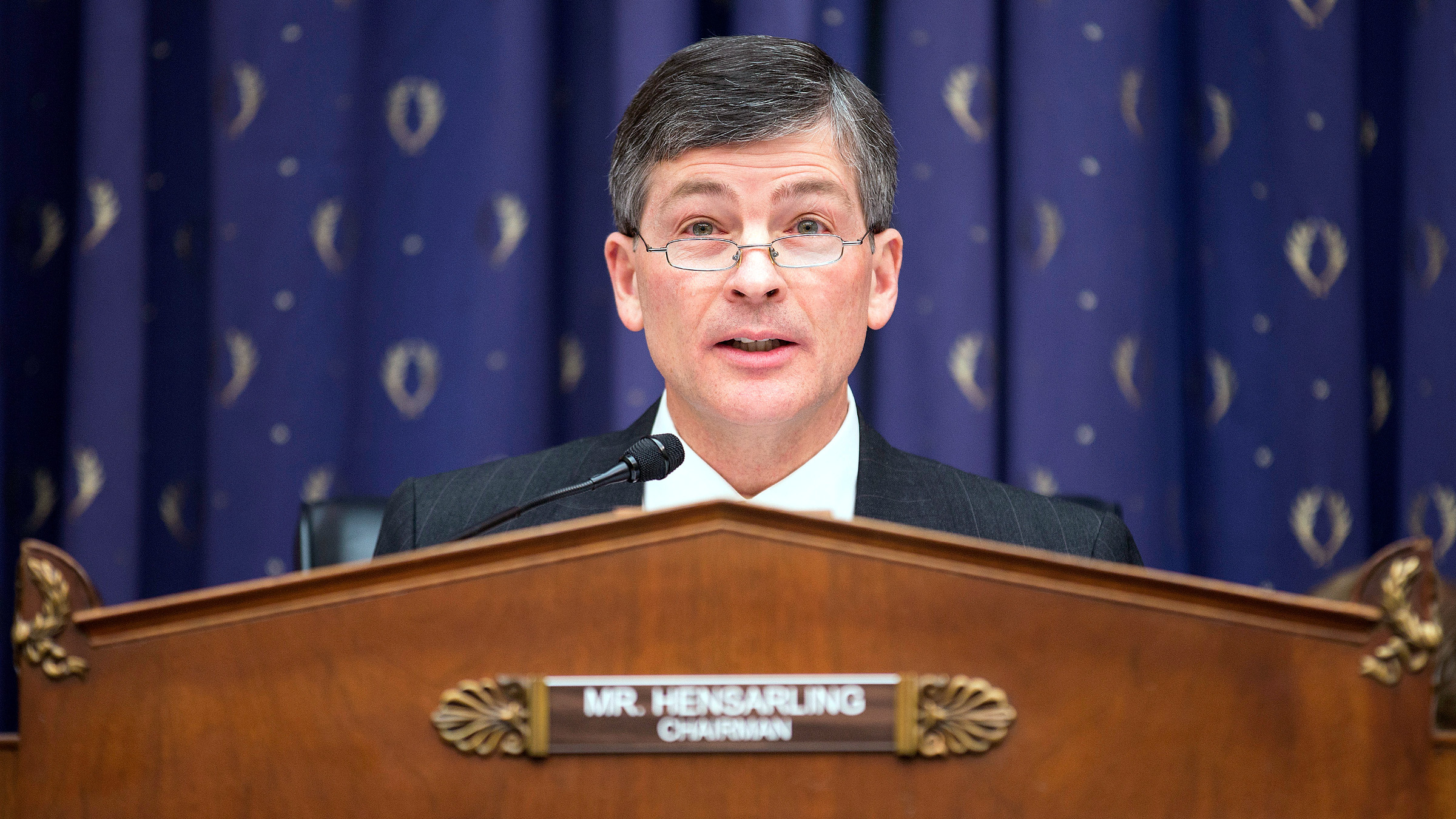 Chairman of the House Financial Services Committee, Jeb Hensarling (R-TX) questions financial regulators about the effects of the Volcker Rule on employment in Washington on February 5, 2014.